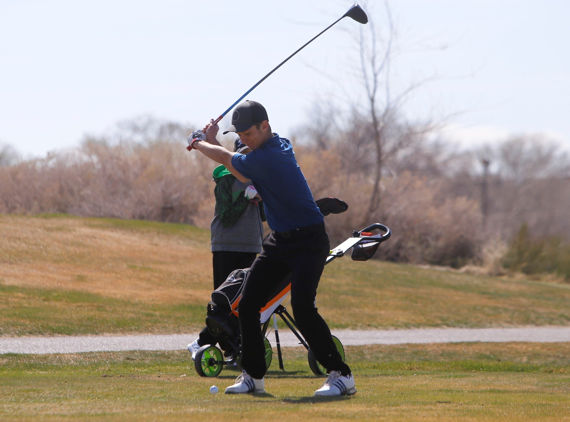 Piedra Vista's Aidan Miller prepares to hit his ball from the 11th tee box during Monday's Shiprock Invitational at Riverview Golf Course in Kirtland.