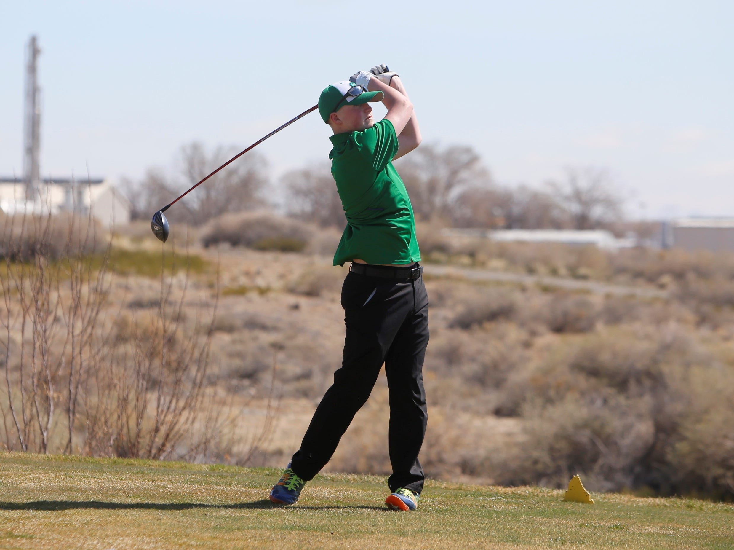 Farmington's Kade Hill watches his ball soar from the 18th tee box during Monday's Shiprock Invitational at Riverview Golf Course in Kirtland.
