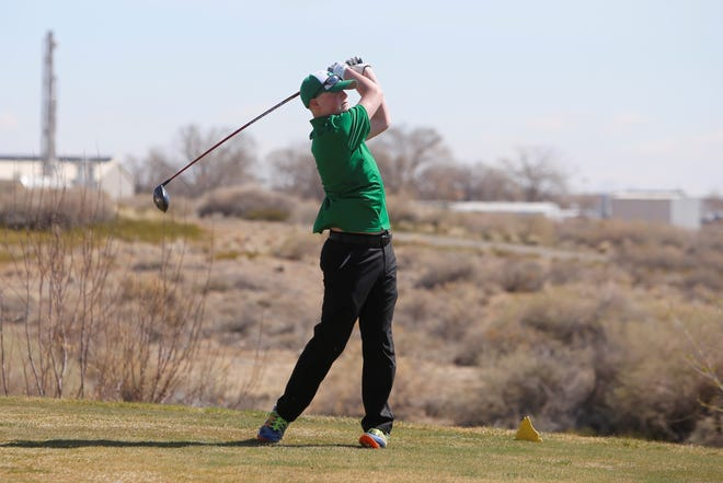 Farmington's Kade Hill watches his ball soar from the 18th tee box on Monday, April 1, 2019, at Riverview Golf Course in Kirtland. First Tee Four Corners will provide San Juan County's young golfers that extra avenue to hit the greens with weekly rounds of golf at Riverview Golf Course and Farmington's Civitan Golf Course, starting week.