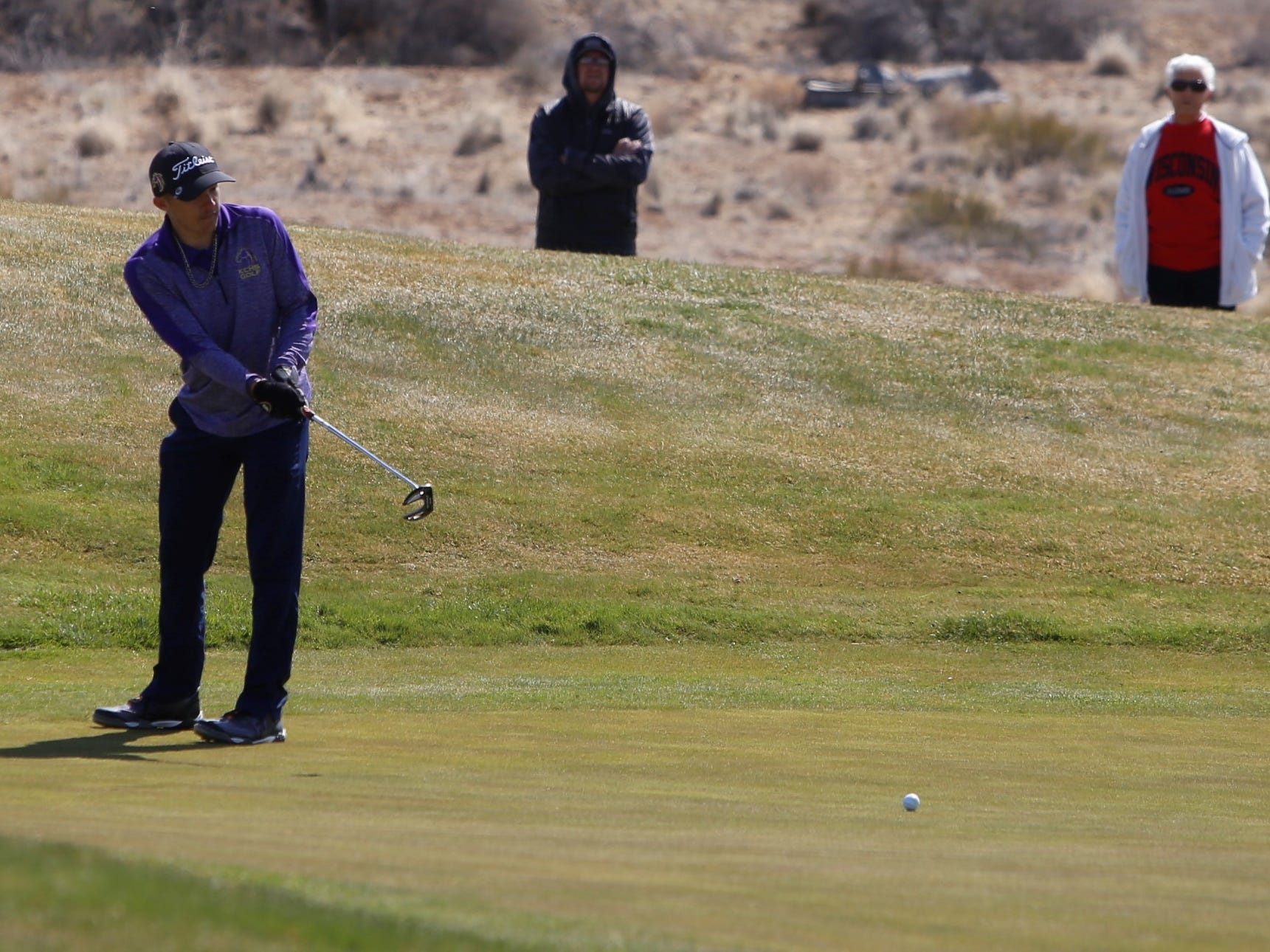 Kirtland Central's Marty Roddy attempts a long putt on the 10th green during Monday's Shiprock Invitational at Riverview Golf Course in Kirtland.