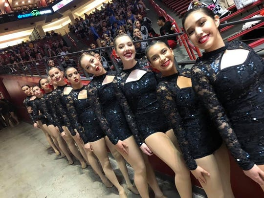 The Farmington High School dance team waits to take center-stage to perform its jazz routine during Saturday's 5A State Spirit Championships at Dreamstyle Arena in Albuquerque. FHS placed sixth out of 21 teams in 5A's dance competition.