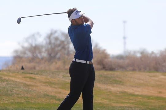 Piedra Vista's Justin Harris watches his ball soar from the 11th tee box during Monday's Shiprock Invitational at Riverview Golf Course in Kirtland.
