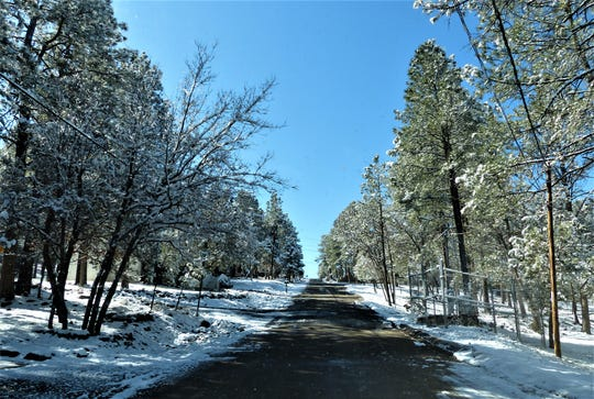 One of the village's steeper roads was clear despite snow-covered ground.