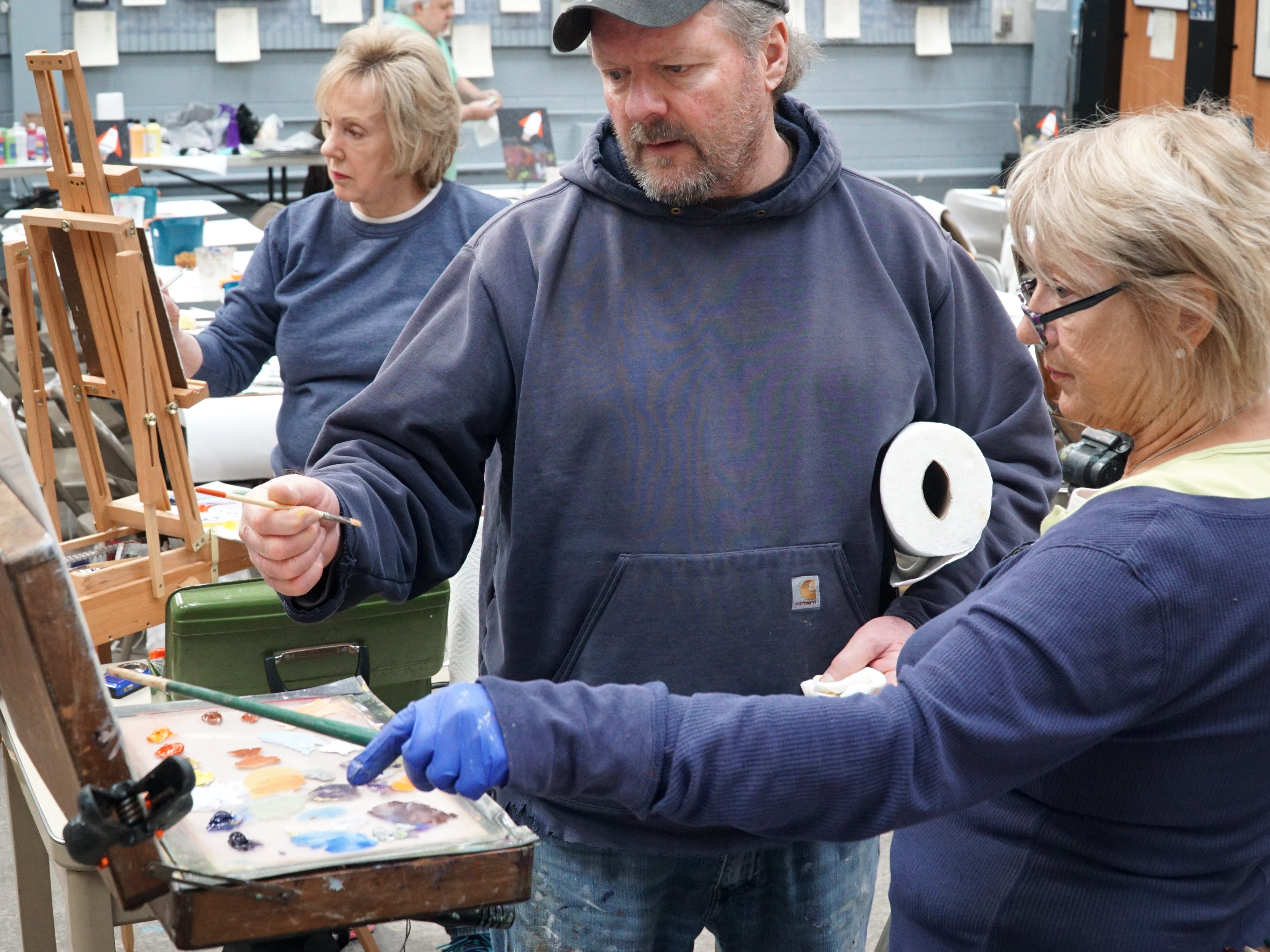 Mike Todoroff, center, talks with student Lyn Banks during his April 1 Oil Paining From Life class at the Suzanne Haskew Arts Center in Milford. The class met from 10a.m. to noon that day and had four students that were painting a still life of a pineapple. The SHAC has lots of classes for people of all ages and abilities. For more inforamaiton contact them at (248) 797-3060 or visit the location at 125 S Main St #700, in Milford. Online at milfordshac.org.