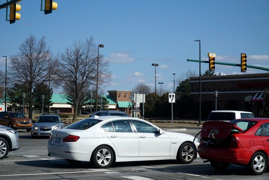 Novi is considering widening Crescent Boulevard, seen at left, as it exits Novi Town Center - as at rush hour it is bottled up by commuters coming up and down Novi Road.