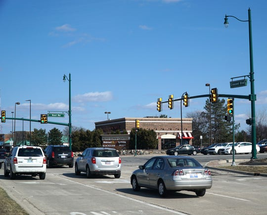 Crescent Boulevard eastbound as it enters Novi Road just south of  I-96.