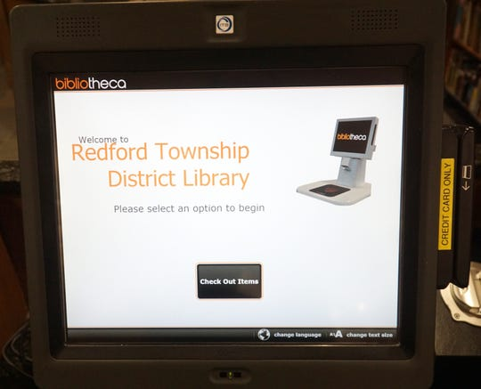 The screen of a self-checkout kiosk at the Redford Township District Library.