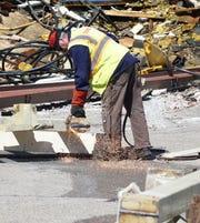 On April 1, 2019, a worker with Dore Associates uses a torch to cut a large I-beam in half during the continuing demolition of the Northville Main Street School building.