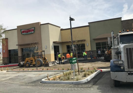Construction crews pave the drive-through area of the new Krispy Kreme Doughnuts at 72787 Dinah Shore Drive, Rancho Mirage, on Monday morning, April 1, 2019. The much-anticipated Krispy Kreme is set to open on April 16.