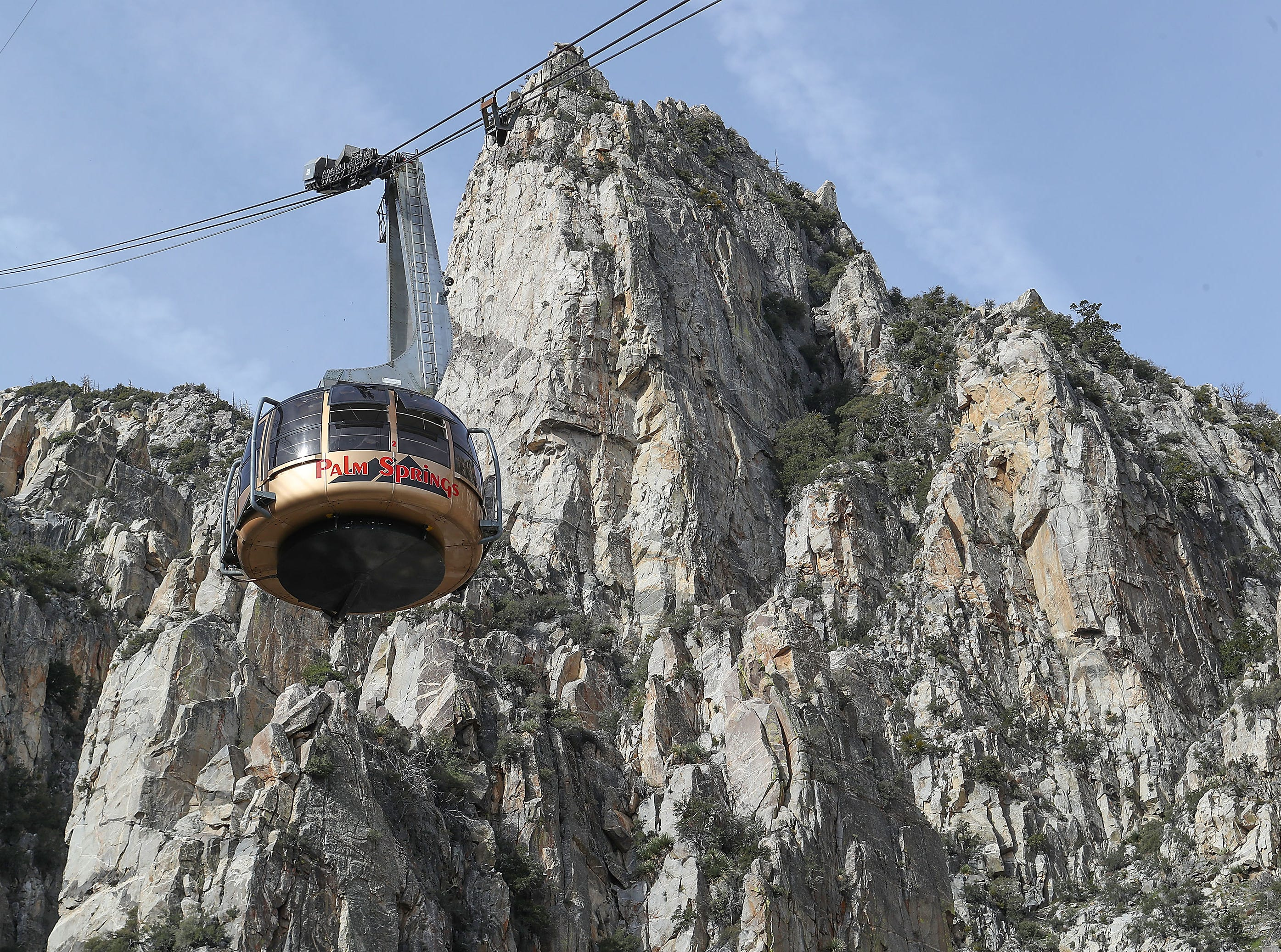 A tramcar at the Palm Springs Aerial Tramway makes its way down Mount San Jacinto Monday, April 1, 2019. The tramway reopened Monday after a February rainstorm washed away part of the road leading to the tram.