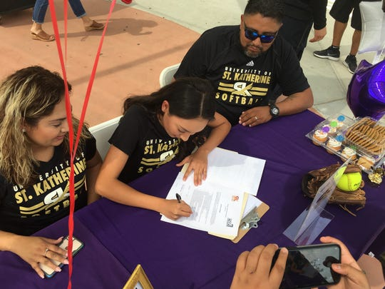 Shadow Hills softball player Alexia Terrazas signs her letter of intent Monday to continue her career in college. She was one of three Knights signing their LOIs at the celebration.