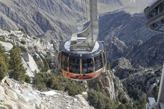 Visitors to the Palm Springs Aerial Tramway ride it to the top of Mount San Jacinto, April 1, 2019. The tram reopened that day after being closed since a February rainstorm.