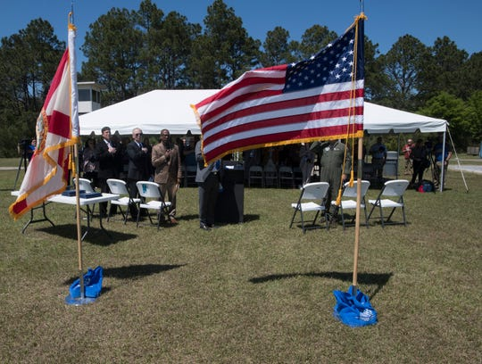 Escambia County officials gather Monday at the former Navy Outlying Field 8 to commemorate the land swap.