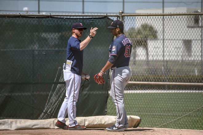 Blue Wahoos pitcher Brusdar Graterol, shown talking with pitching coach Justin Willard during spring training in Fort Myers, will be part of the team's starting rotation for the season opening series in Mobile.
