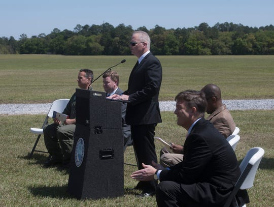 Escambia County Commissioner, Jeff Bergosh offers his remarks during a ceremony to commemorate the transfer of the former Navy Outlying Landing Field Site Eight to the county on Monday, April 1, 2019.