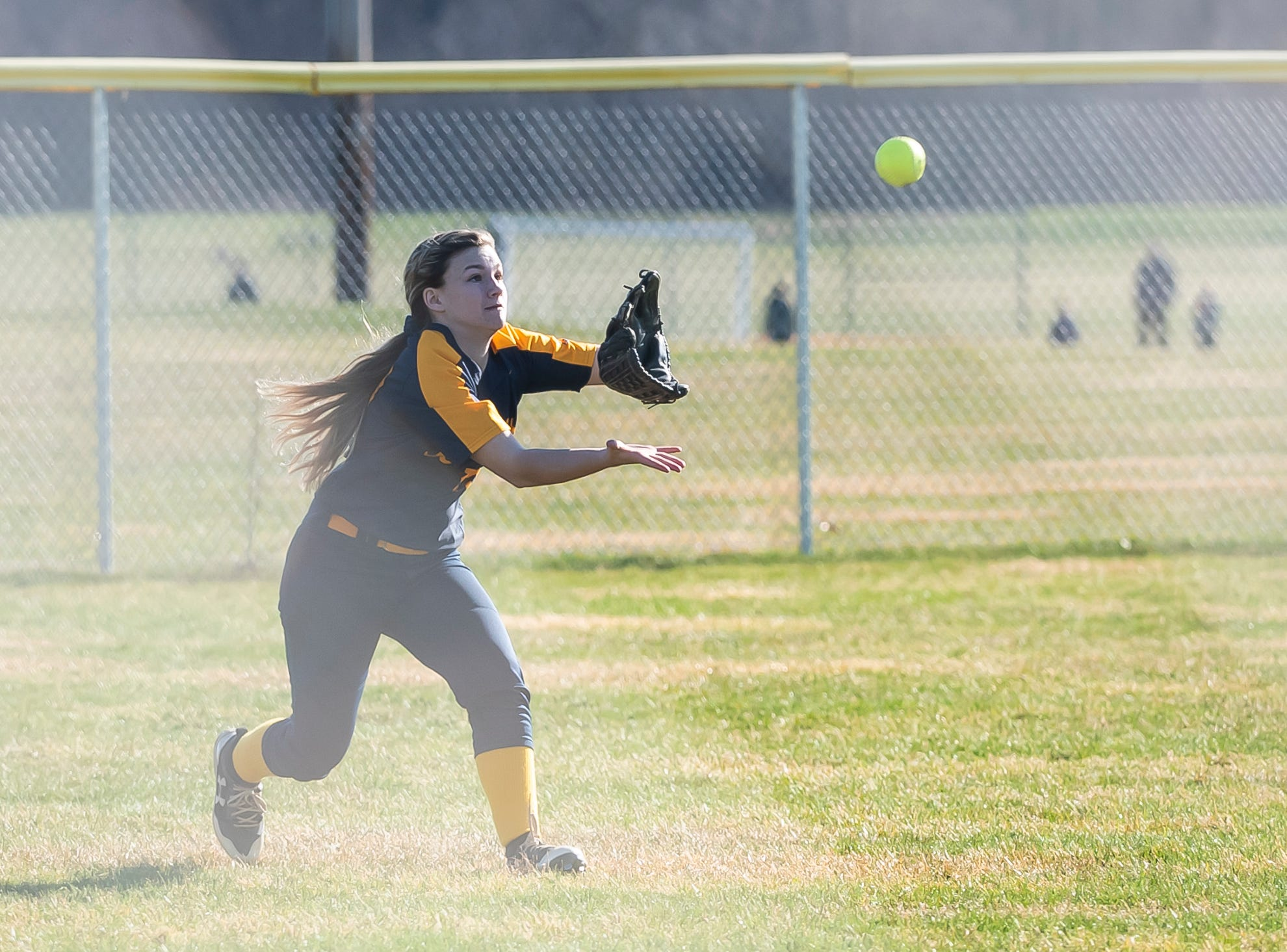 Littlestown's Carli Thayer catches a fly ball during a YAIAA softball game against Gettysburg on Monday, April 1, 2019. The Bolts won 10-4.