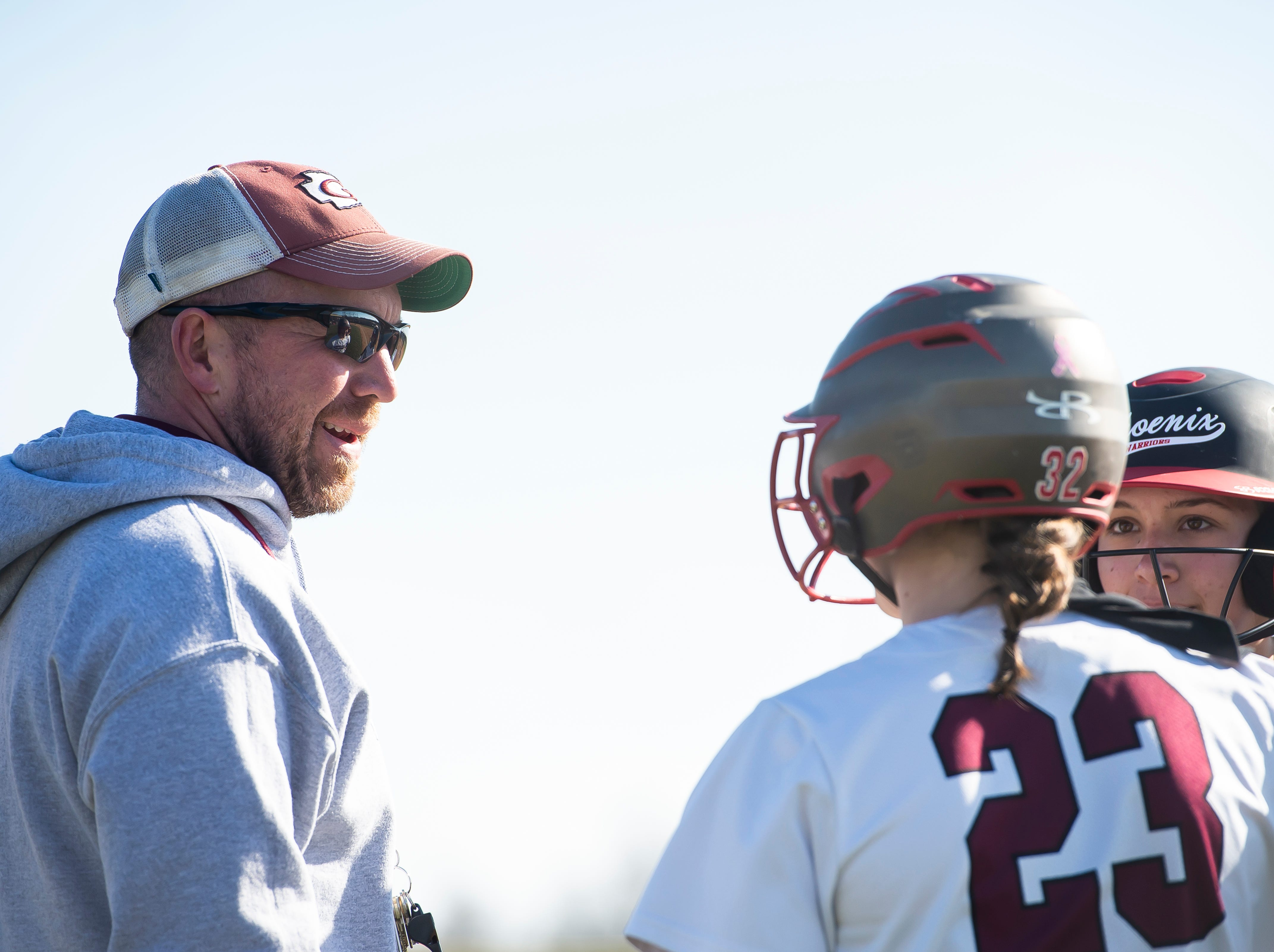 Gettysburg head coach Max Laing speaks with Rachel Keller (23) and Kaelyn Blocher during a pause in play in a YAIAA softball game against Littlestown on Monday, April 1, 2019. The Bolts won 10-4.