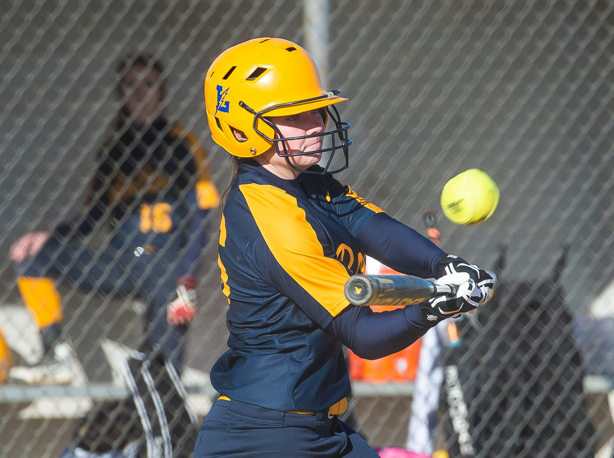 Littlestown's Molly Watkins makes contact with the ball during a YAIAA softball game against Gettysburg on Monday, April 1, 2019. The Bolts won 10-4.