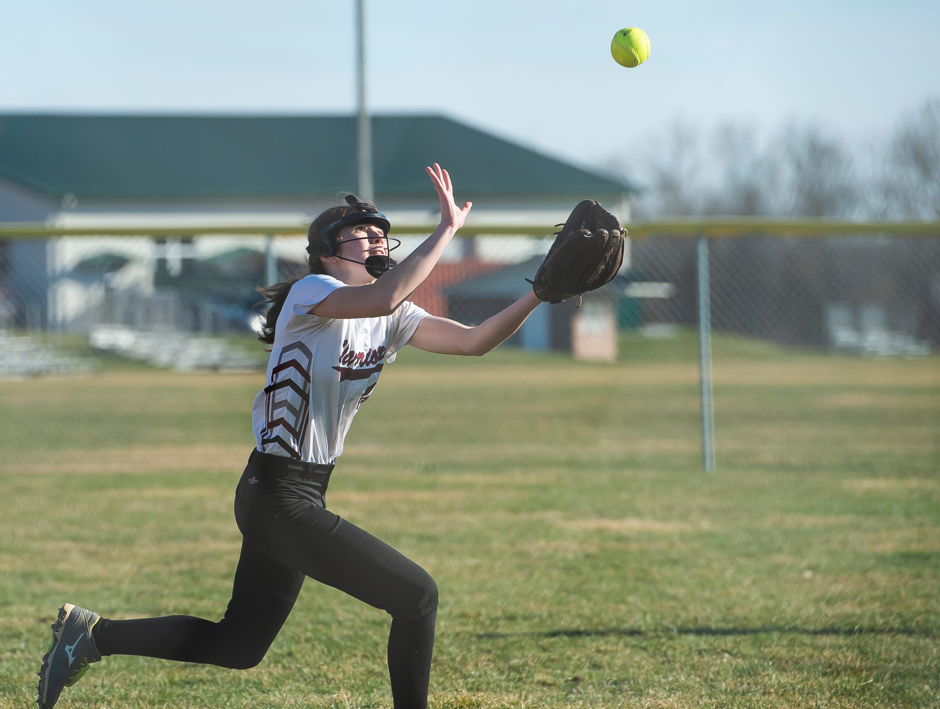 Gettysburg's Hayley Cisney comes up a little short of catching a fly ball during a YAIAA softball game against Littlestown on Monday, April 1, 2019. The Warriors fell 10-4.