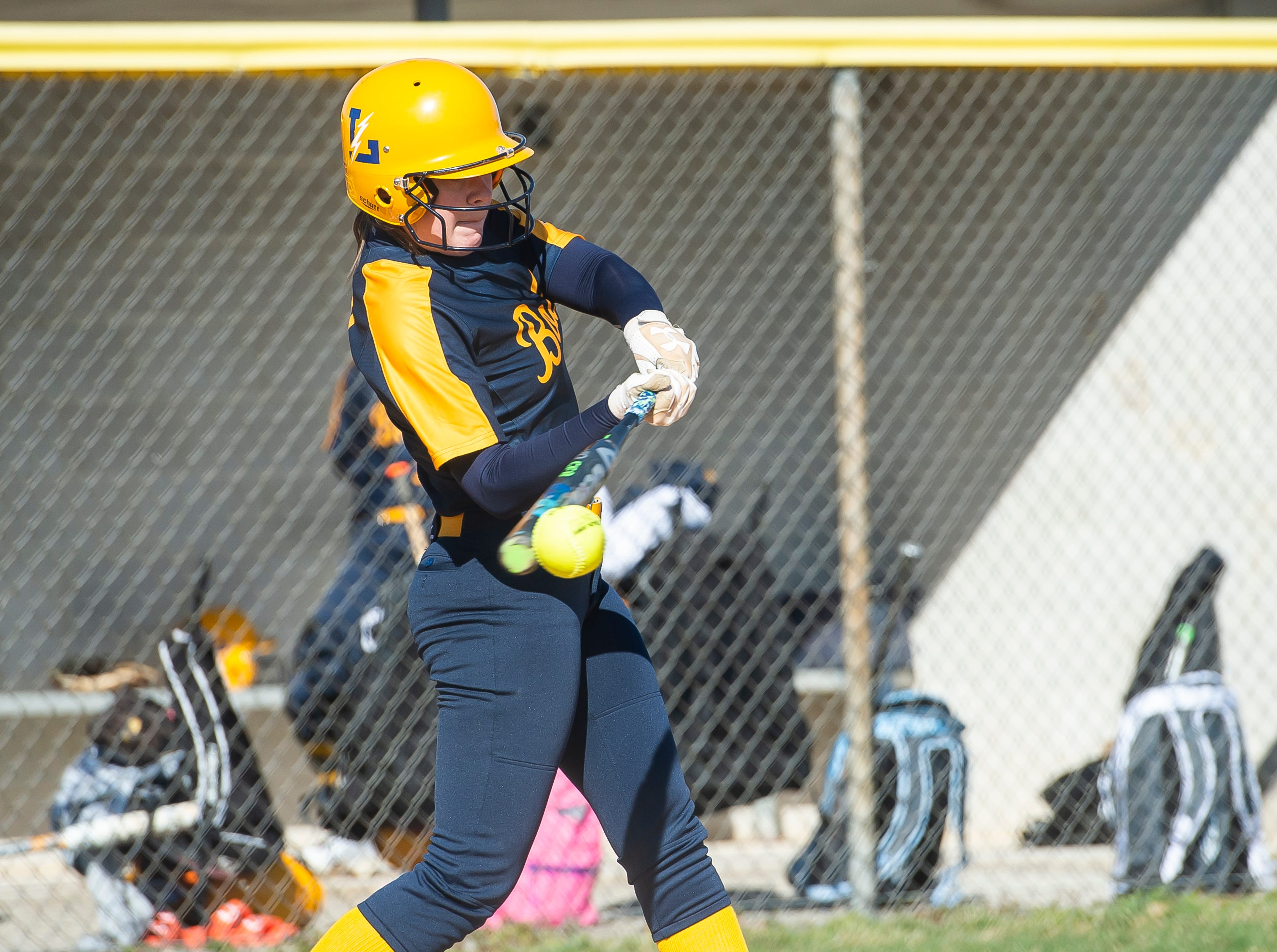 Littlestown's Kacie Frock connects with the ball during a YAIAA softball game against Gettysburg on Monday, April 1, 2019. The Bolts won 10-4.