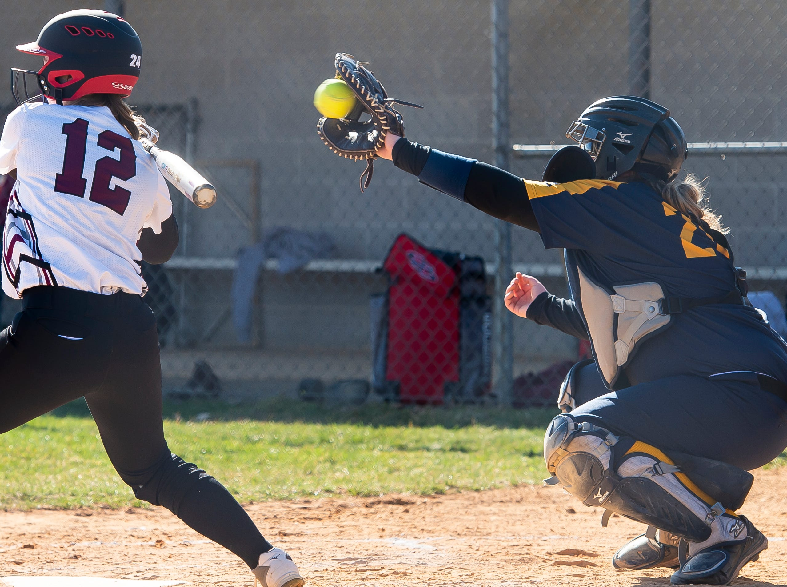 Littlestown catcher Bailey Smith gloves a pitch from pitcher Amaya Bowman during a YAIAA softball game against Gettysburg on Monday, April 1, 2019. The Bolts won 10-4.