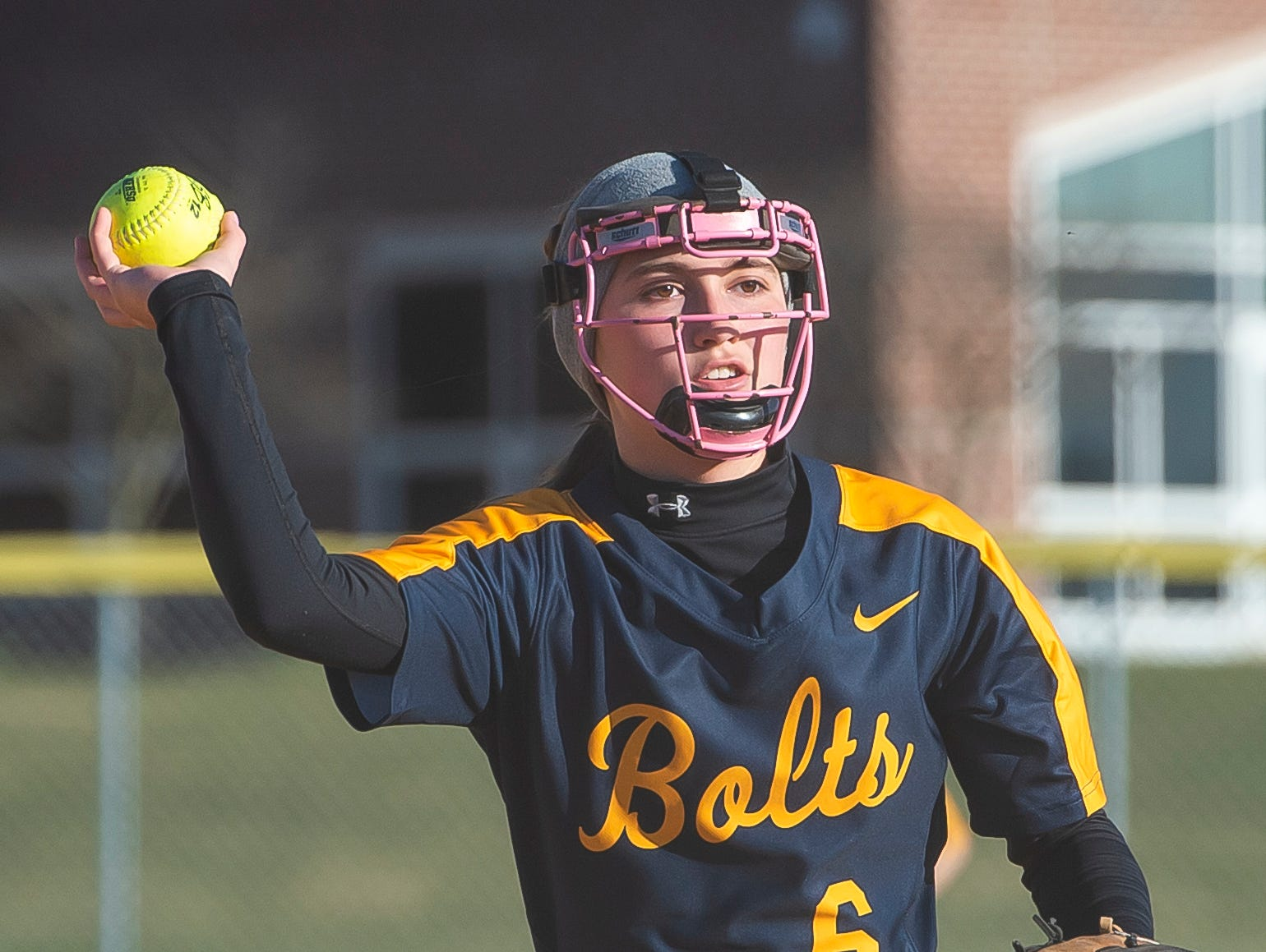 Littlestown's Carter Clabaugh throws the ball to first after fielding a ground ball during a YAIAA softball game against Gettysburg on Monday, April 1, 2019. The Bolts won 10-4.