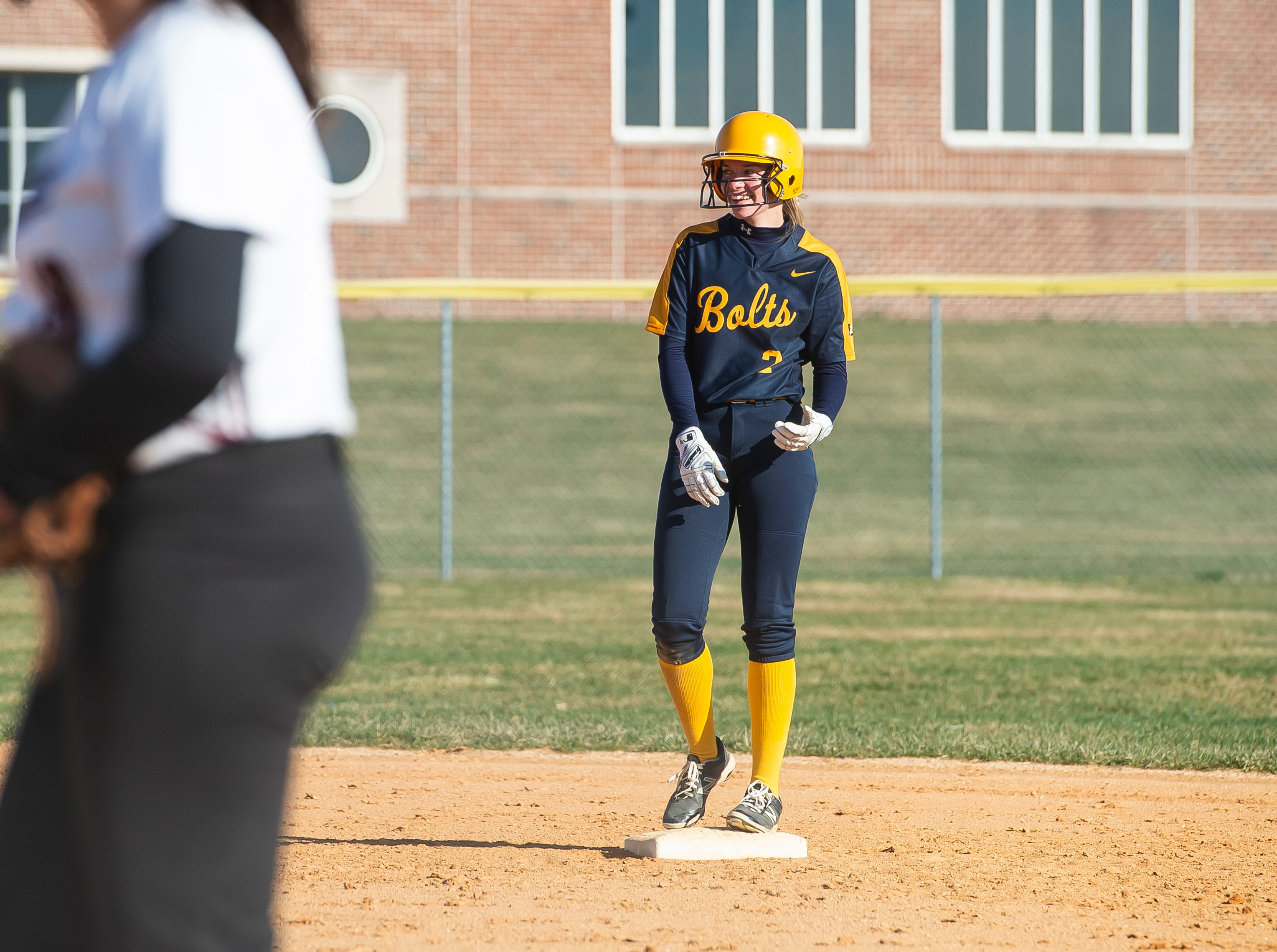 Littlestown's Caitlin Eader smiles on second after getting a steal during a YAIAA softball game against Gettysburg on Monday, April 1, 2019. The Bolts won 10-4.