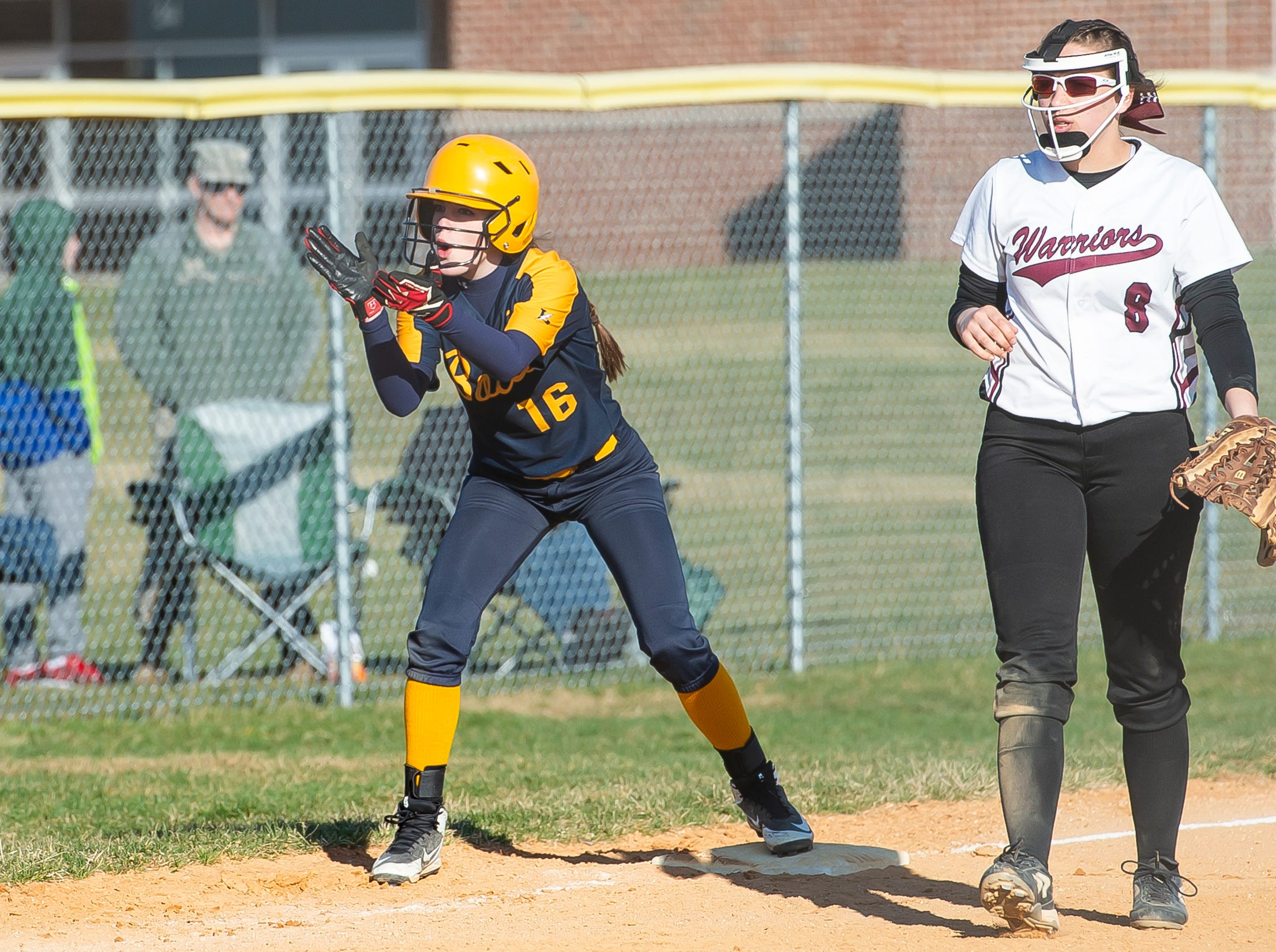 Littlestown's Jada Mummert cheers on her teammates from third base after the Bolts scored during a YAIAA softball game against Gettysburg on Monday, April 1, 2019. The Bolts won 10-4.