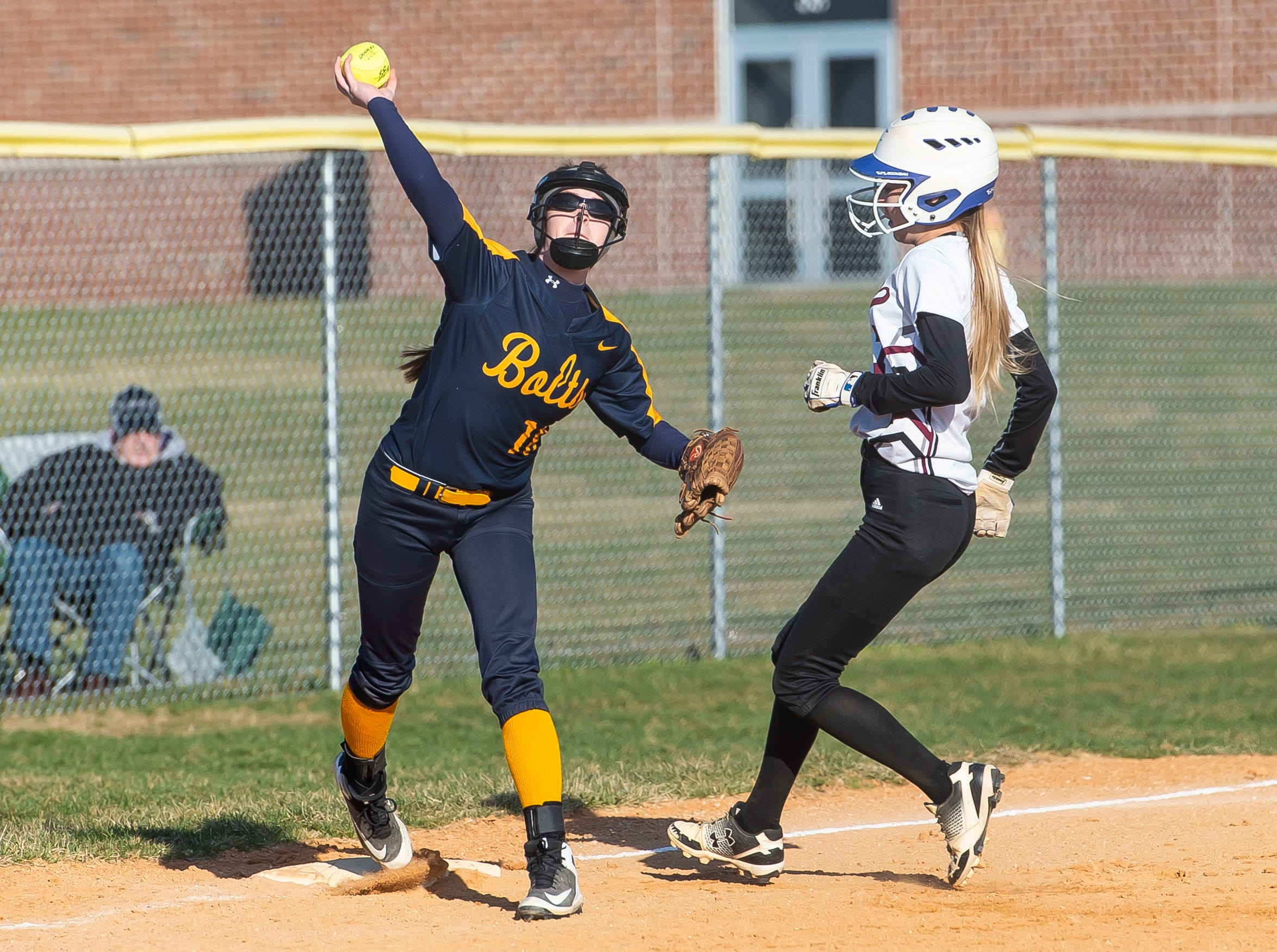 Littlestown third baseman Jada Mummert throws the ball to first after fielding a ground ball and getting the force out at third in a YAIAA softball game against Gettysburg on Monday, April 1, 2019. The Bolts won 10-4.