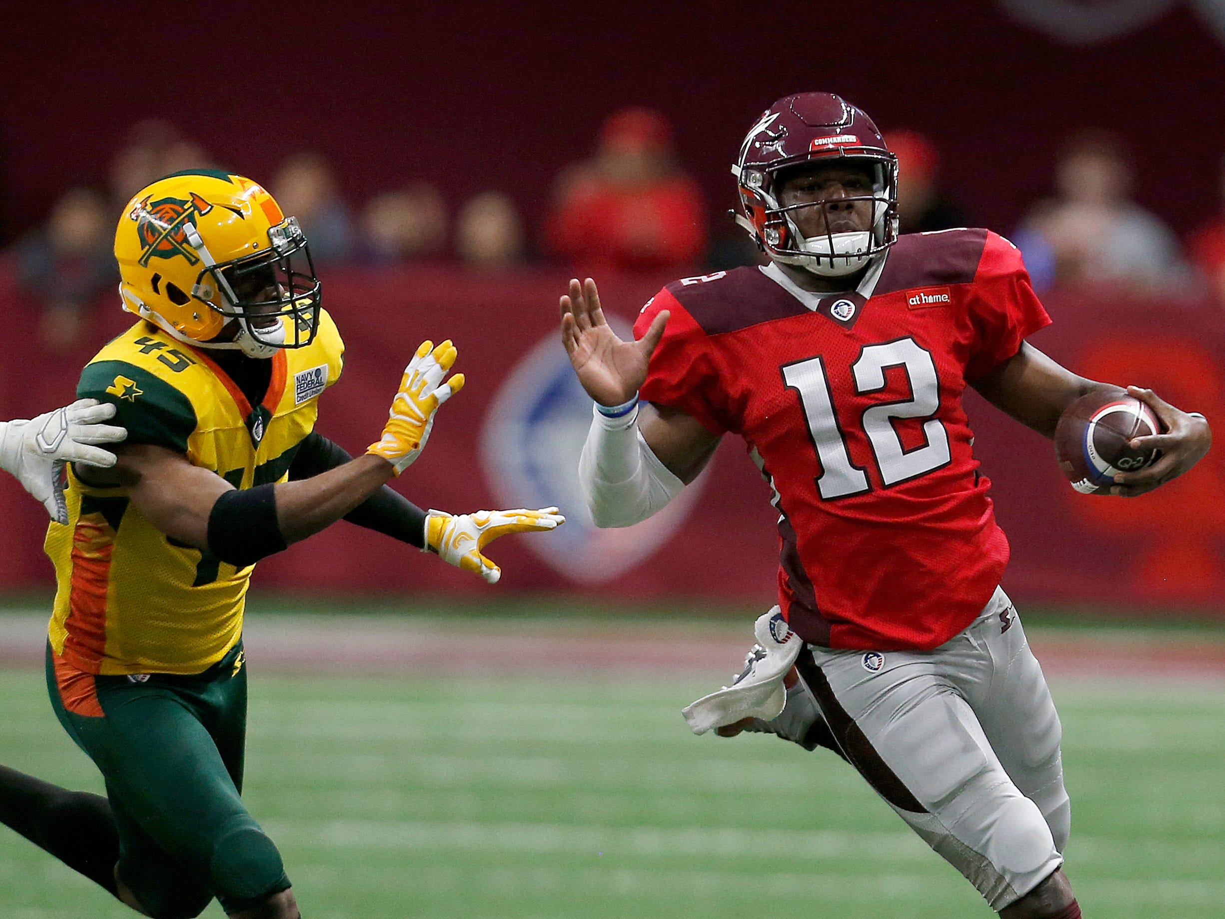 San Antonio Commanders quarterback Marquise Williams (12) runs the ball past Arizona Hot Shots defensive back Rahim Moore (45) in the first half during an Arizona Hotshots at San Antonio Commanders AAF football game, Sunday, March 31, 2019, at the Alamodome in San Antonio.