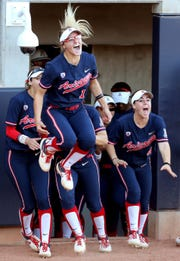 The Wildcat bench, led by Arizona's Ivy Davis (12) pours out of the dugout to celebrate Alyssa Palomino-Cardoza's two run homer against Arizona State in the third inning of their Pac-12 game at Hillenbrand Stadium, Saturday, March 30, 2019, Tucson, Ariz.