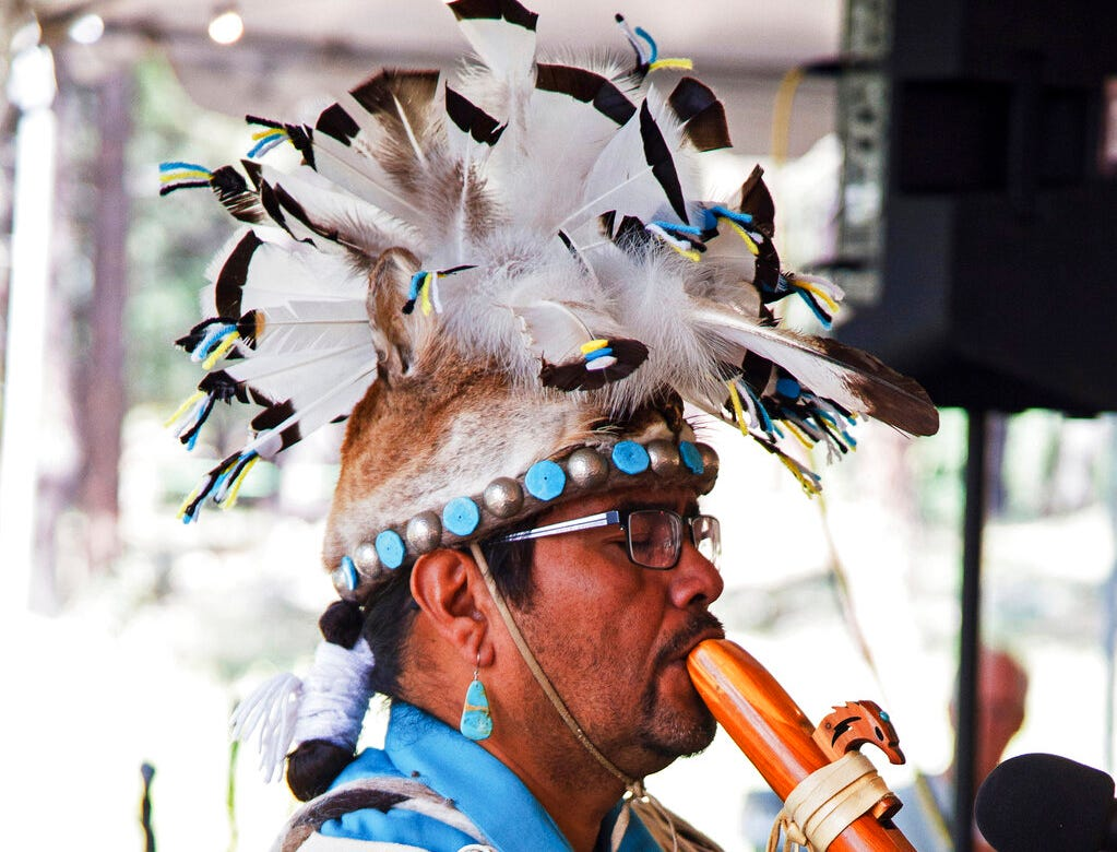 An unidentified man wears a headpiece fashioned out of an animal hide at the Navajo Festival of Arts and Culture in Flagstaff. The hide did not come from a state wildlife repository, but the photo shows how Native Americans use animal parts for religious and cultural purposes. Arizona wildlife officials are on the lookout for bear, bison, badger and other carcasses for Native Americans' religious and cultural use under a unique new program that allows tribes to make requests for various animal parts.