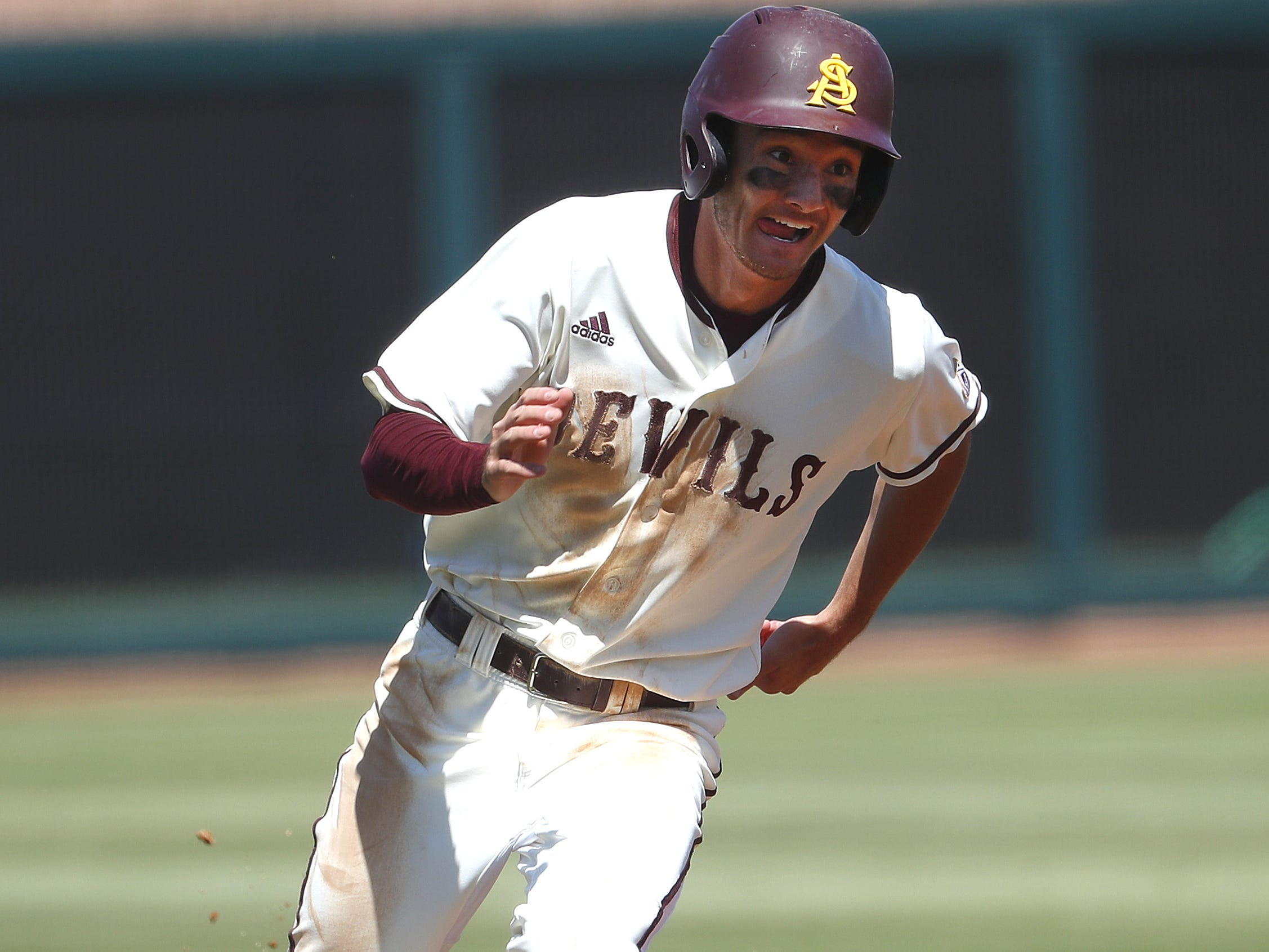 ASU's Alika Williams (5) rounds third past Arizona's Nick Quintana (13) after an error from shortstop Jacob Blas during a game at Phoenix Municipal Stadium in Phoenix, Ariz. on March 30, 2019.