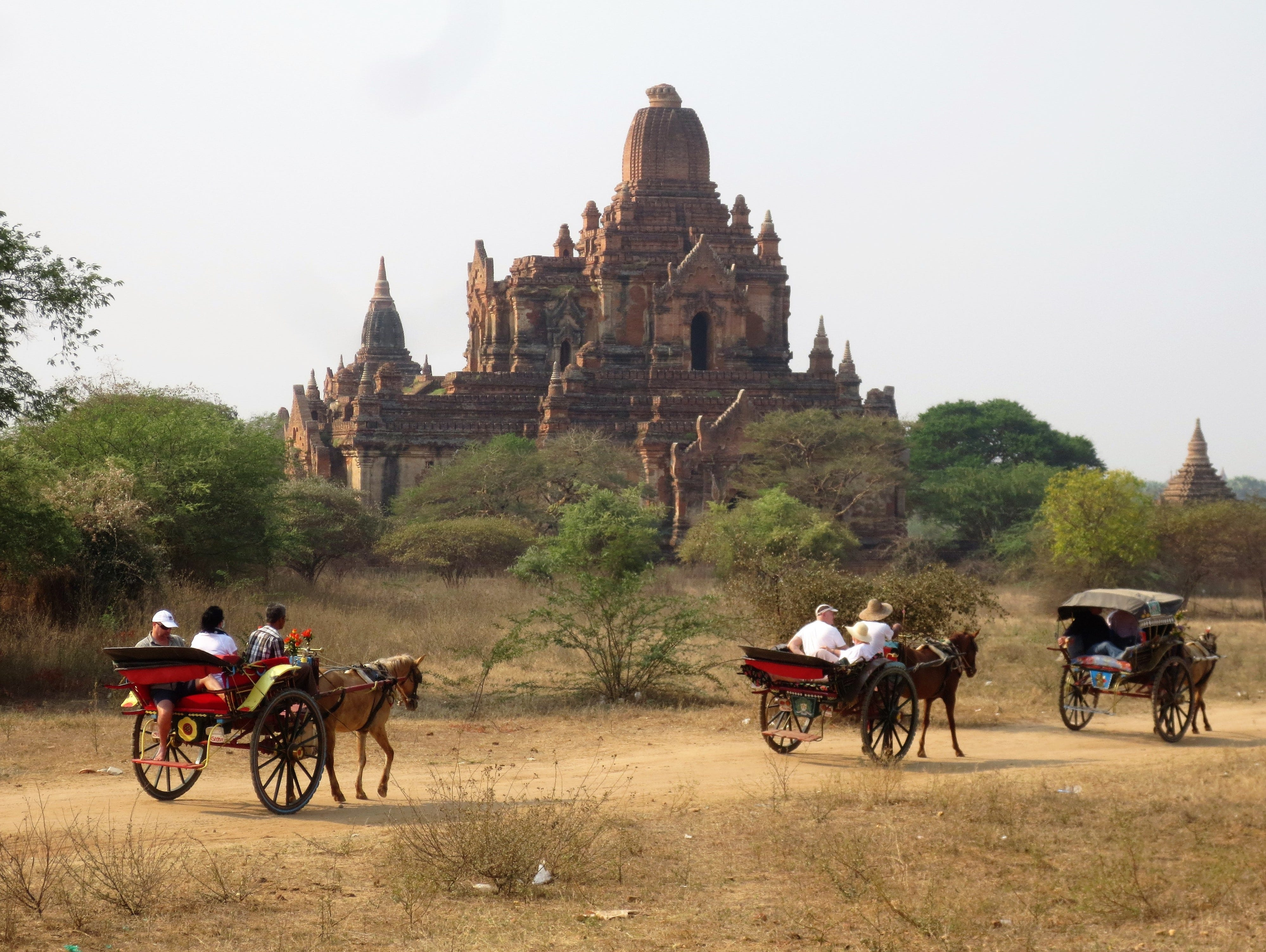 Horse carts take visitors past some of the ancient temples in Bagan, Myanmar.