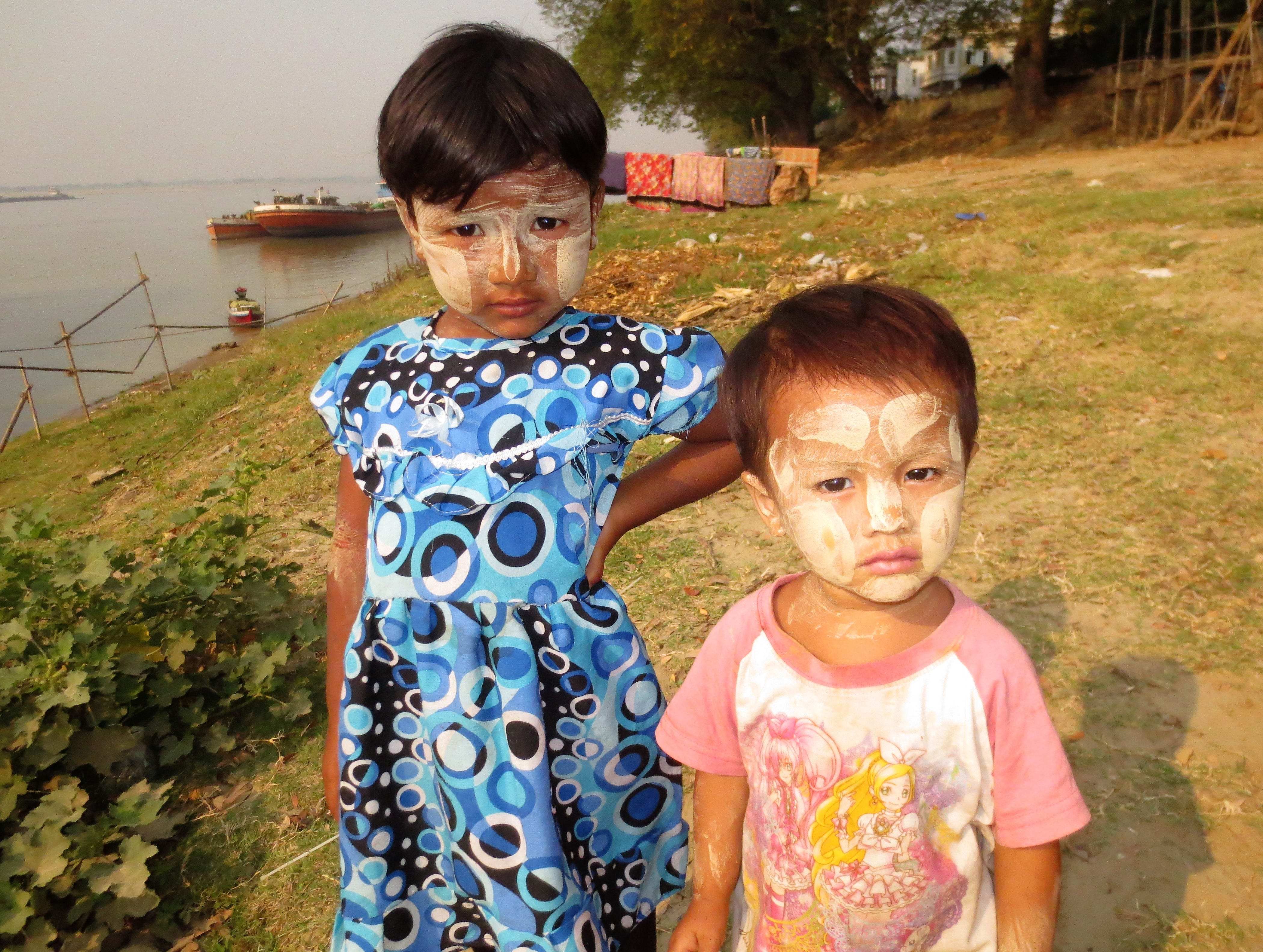 Many Burmese people, including these children who live in a village on the Irrawaddy River, cover their faces with a distinctive makeup called thanaka, made from ground tree bark.