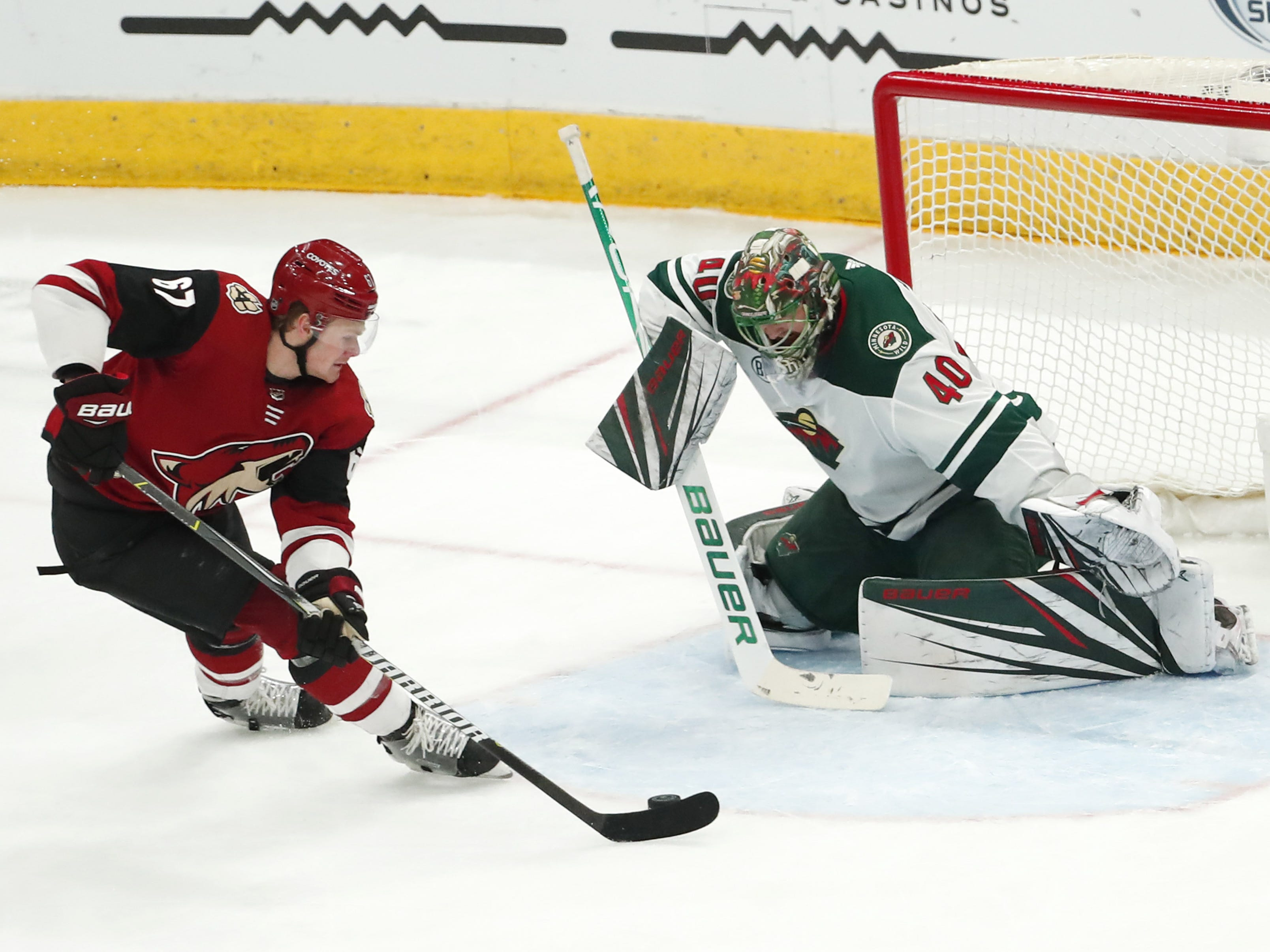 Arizona Coyotes left wing Lawson Crouse (67) breaks away against Minnesota Wild goaltender Devan Dubnyk (40) during the third period in Glendale March 31, 2019.