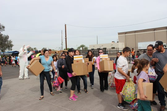Families take home food baskets from Phoenix Rescue Mission's annual Easter Community Celebration in March 2018.