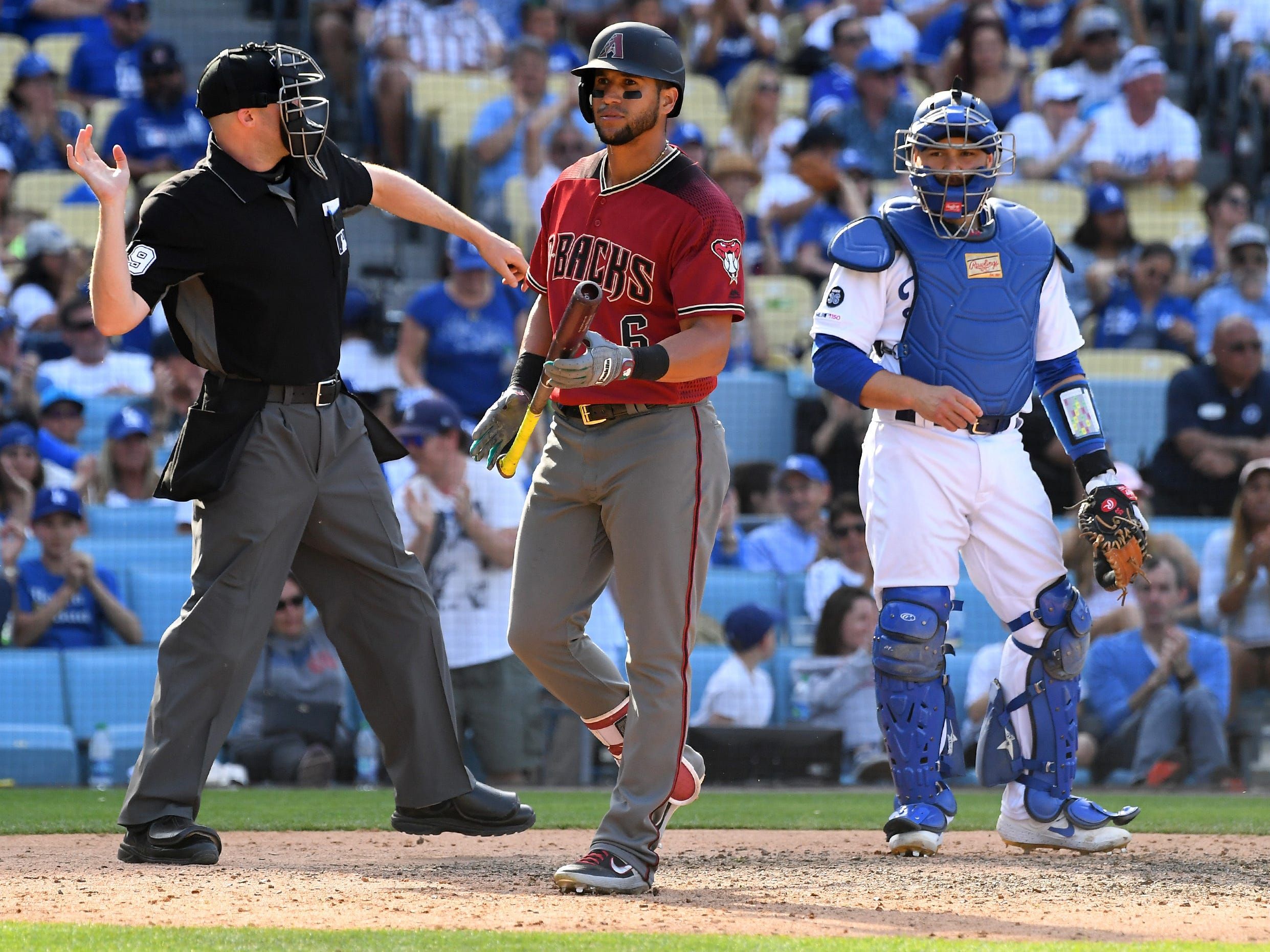 Mar 31, 2019; Los Angeles, CA, USA; Los Angeles Dodgers catcher Russell Martin (55) looks on as home plate umpire Nic Lentz (59) calls Arizona Diamondback left fielder David Peralta (6) out on strikes in the ninth inning of the game at Dodger Stadium.