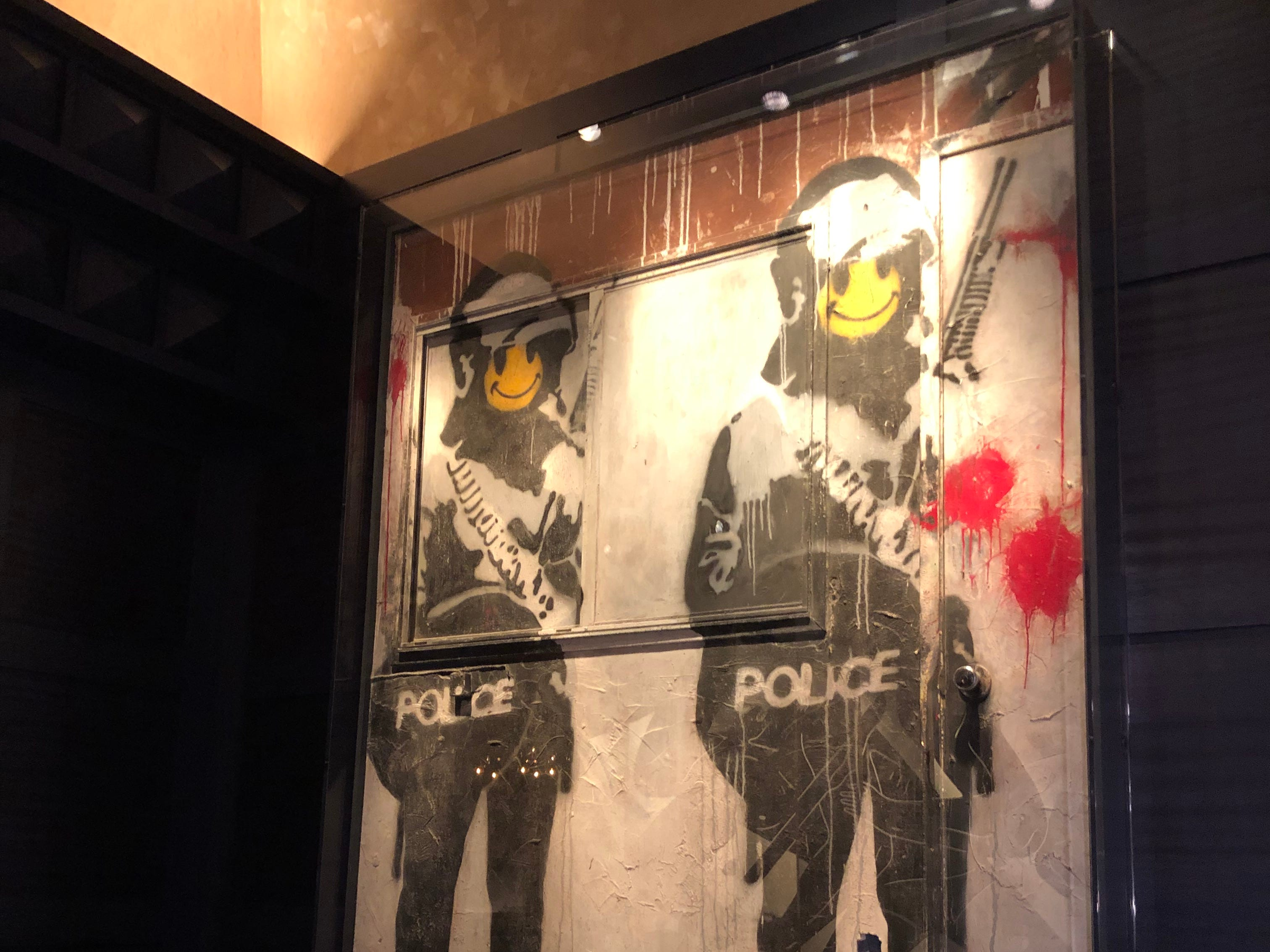 Artwork by Banksy is tucked behind the DJ booth in Greene St. Kitchen in the Palms Casino Resort in Las Vegas.