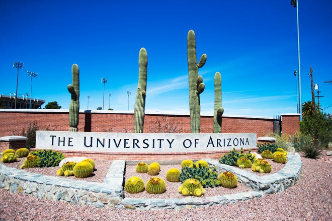 Two students at the University of Arizona will be charged with misdemeanors after a video showing them protesting a Customs and Border Protection event on campus went viral, UA President Robert Robbins announced Friday.