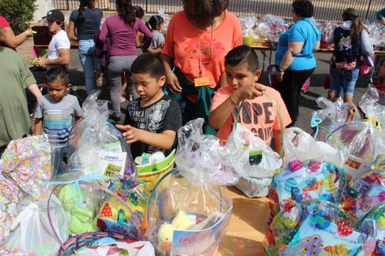 Children pick up donated Easter baskets during Phoenix Rescue Mission's annual Easter Community Celebration in March 2018 at the Transforming Lives Center.