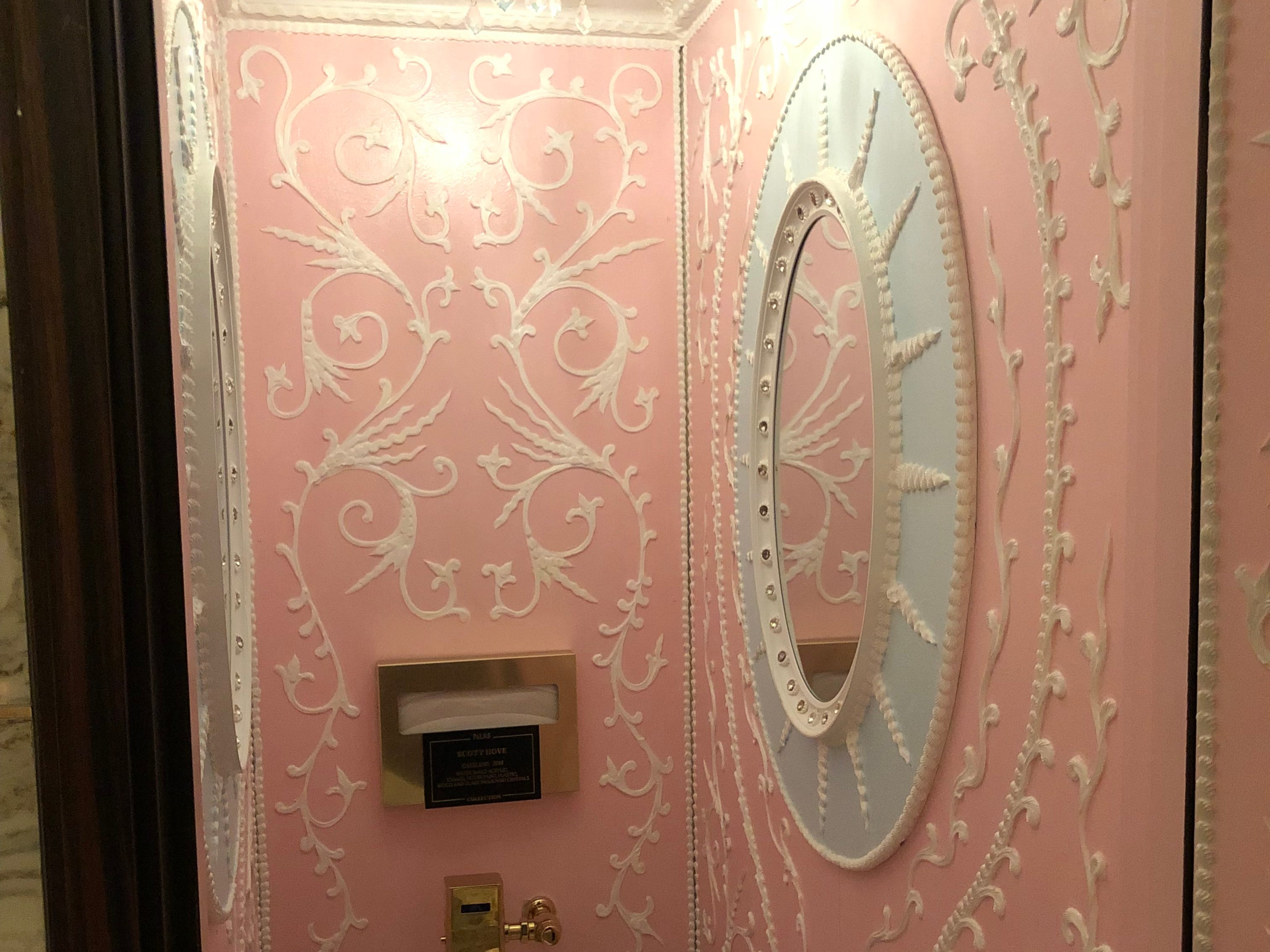 """Some surprise artwork in the women's room near Scotch 80 Prime at the Palms Casino Resort in Las Vegas. The middle stall is an art installation called """"Cakeland"""" by Scott Hove."""