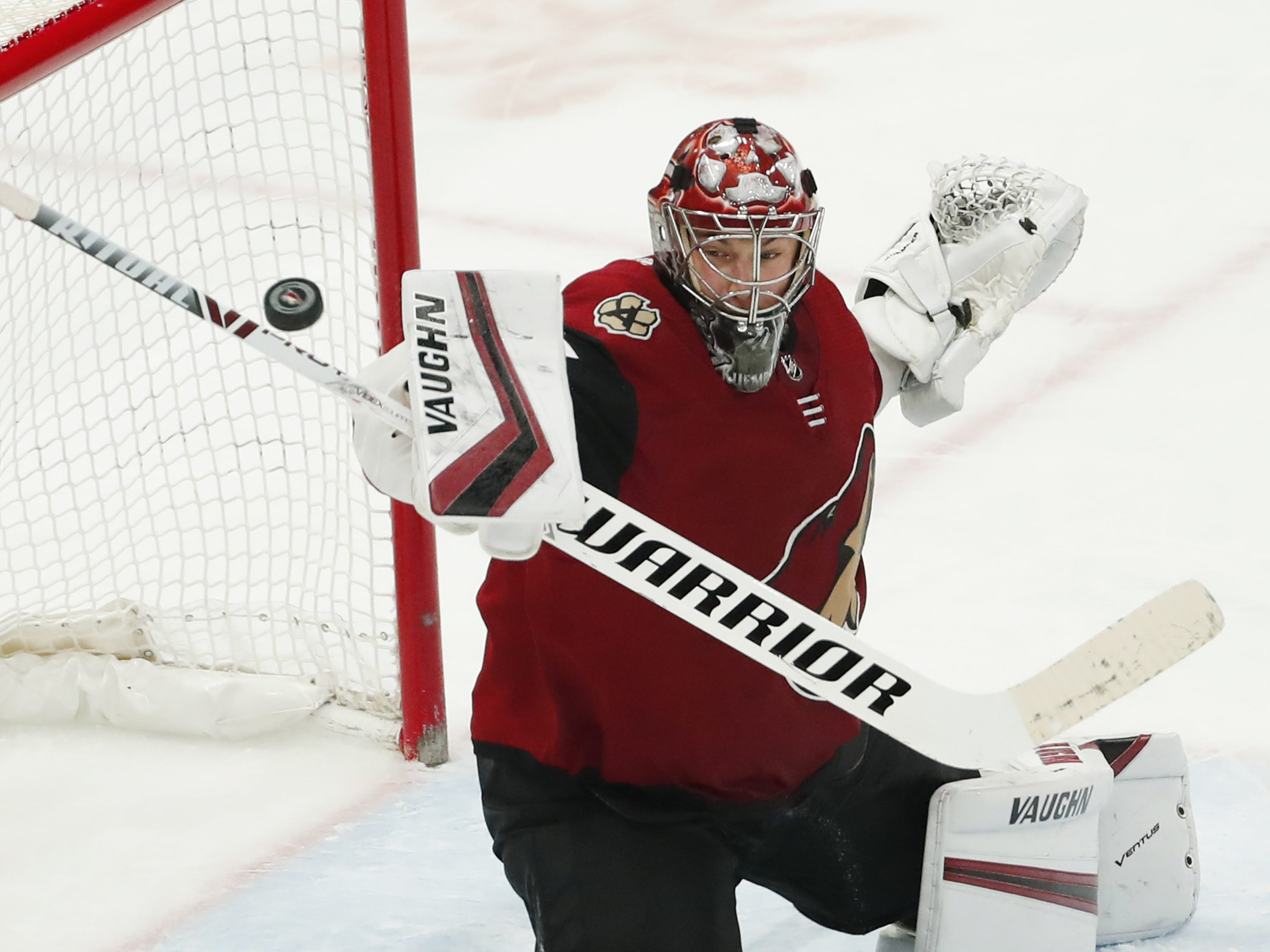 Arizona Coyotes goaltender Darcy Kuemper (35) makes a save against the Minnesota Wild during the third period in Glendale March 31, 2019.