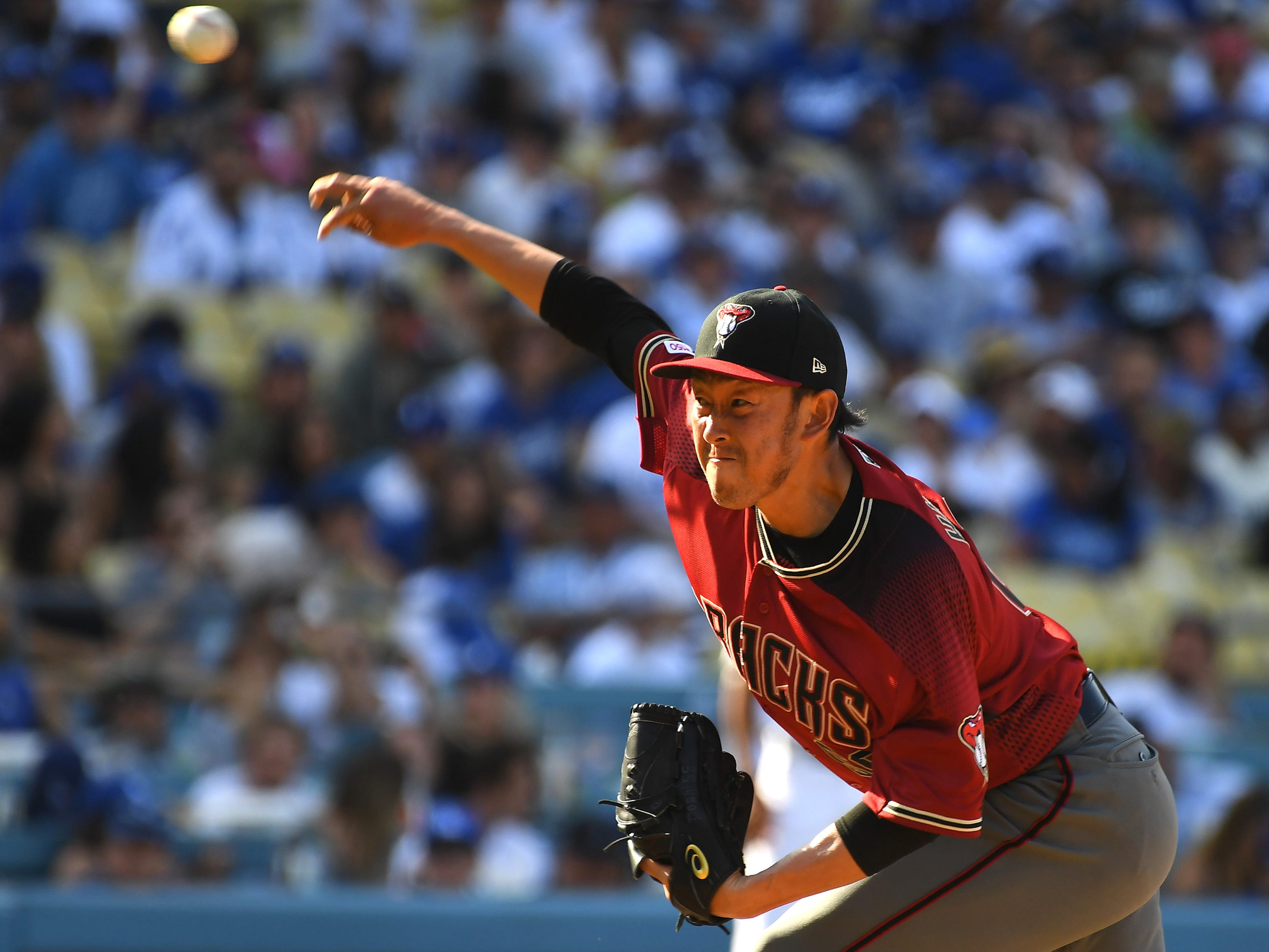 Mar 31, 2019; Los Angeles, CA, USA; Arizona Diamondbacks relief pitcher Yoshihisa Hirano (66) in the eighth inning of the game against the Los Angeles Dodgers at Dodger Stadium.