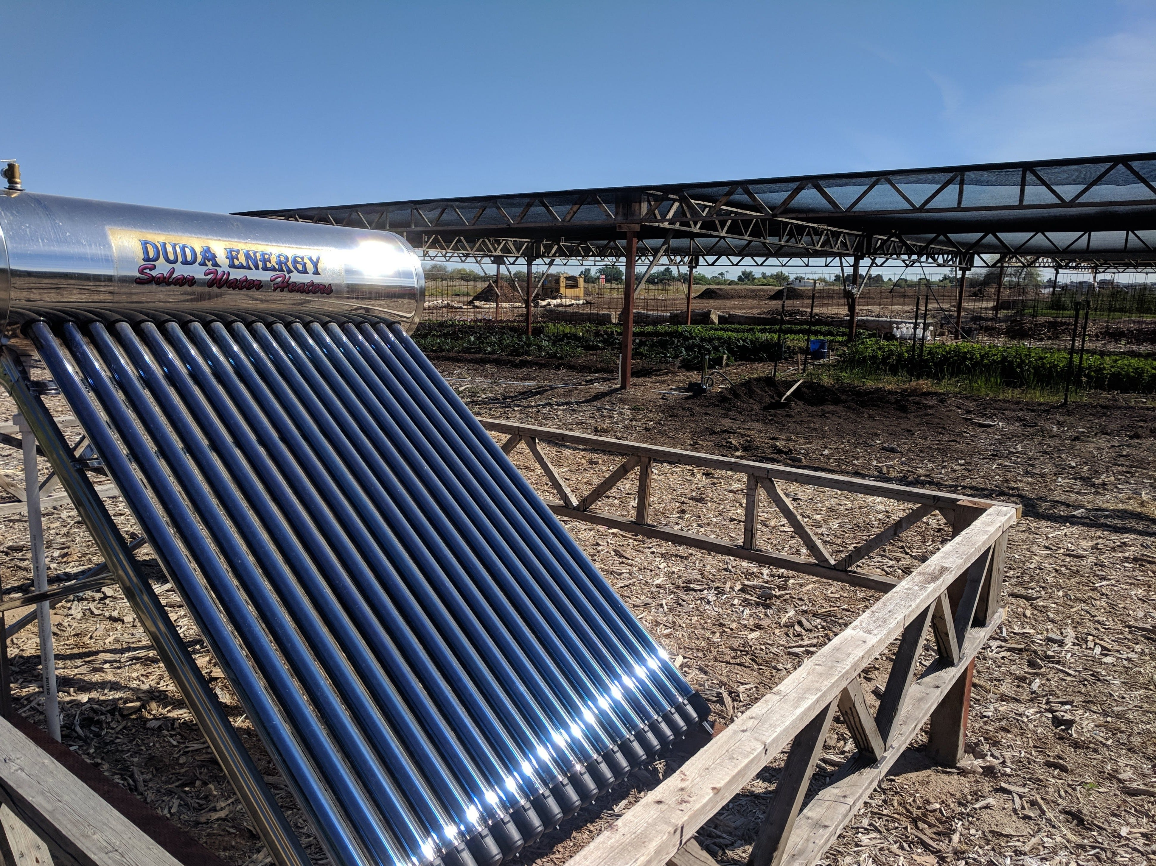 Just outside the farm's robust, covered garden is a solar water heater.