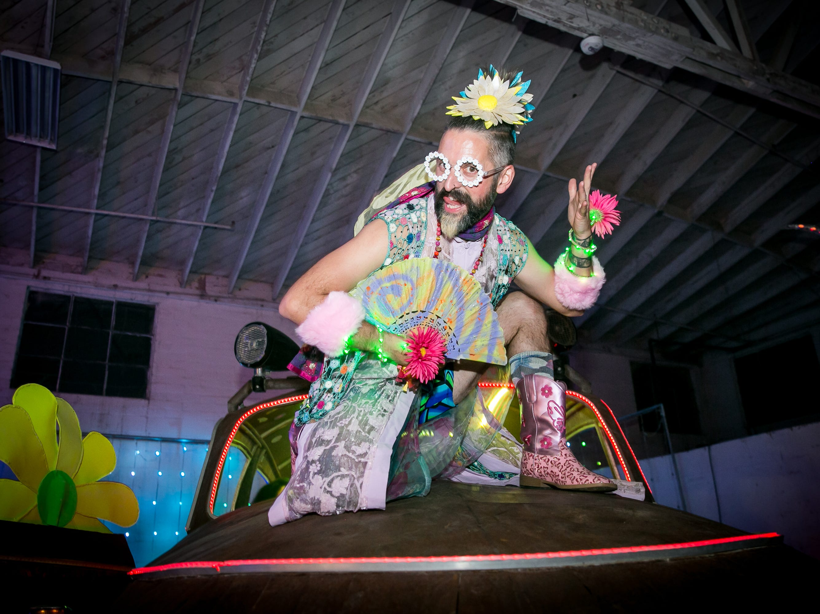 Attendee strikes a pose during Bloom at The Where?House Gallery on March 30, 2019.