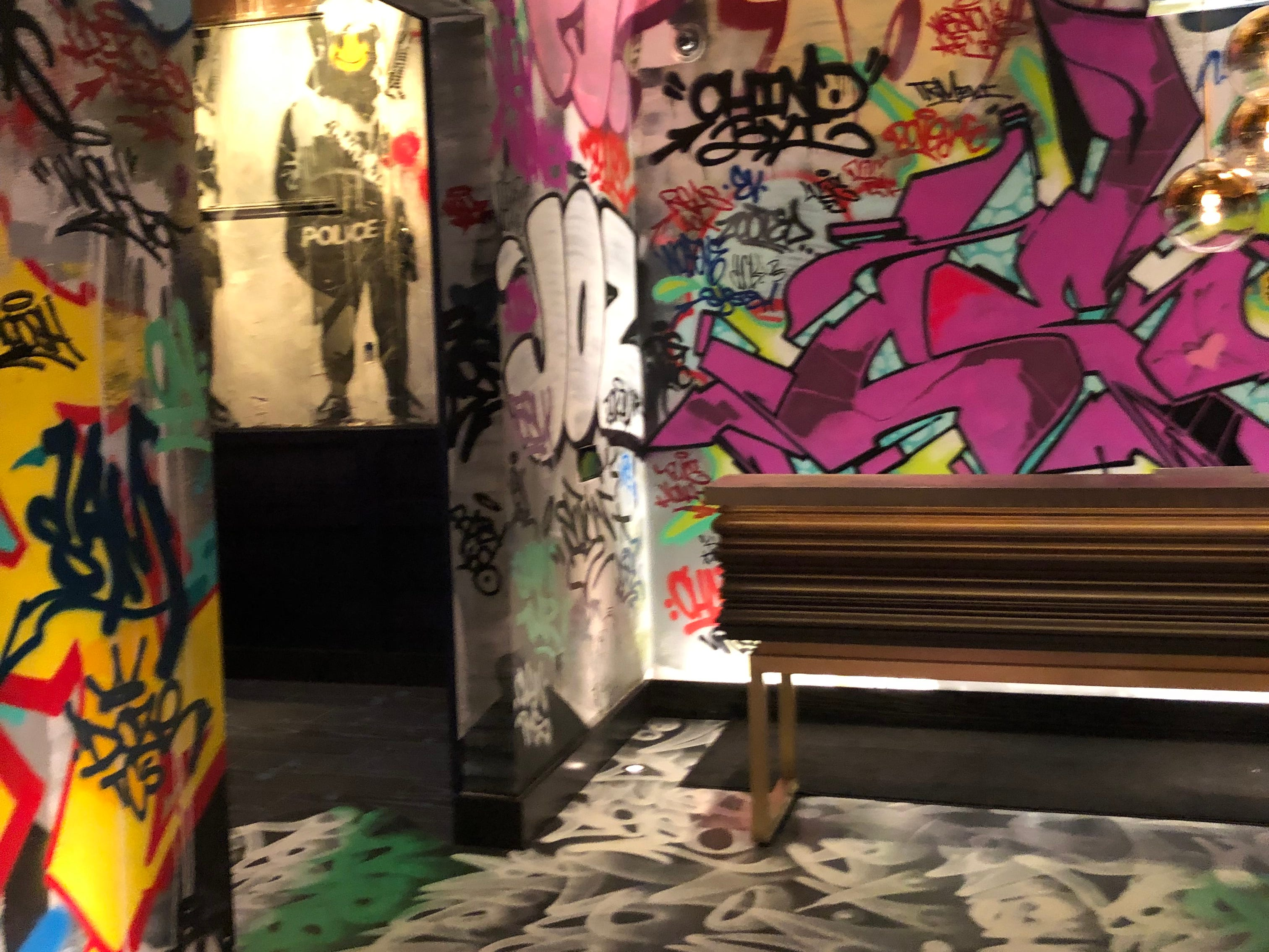 Graffiti entryway into Greene St. Kitchen in the Palms Casino Resort in Las Vegas. Just inside the door to the left is the resort's Banksy artwork.