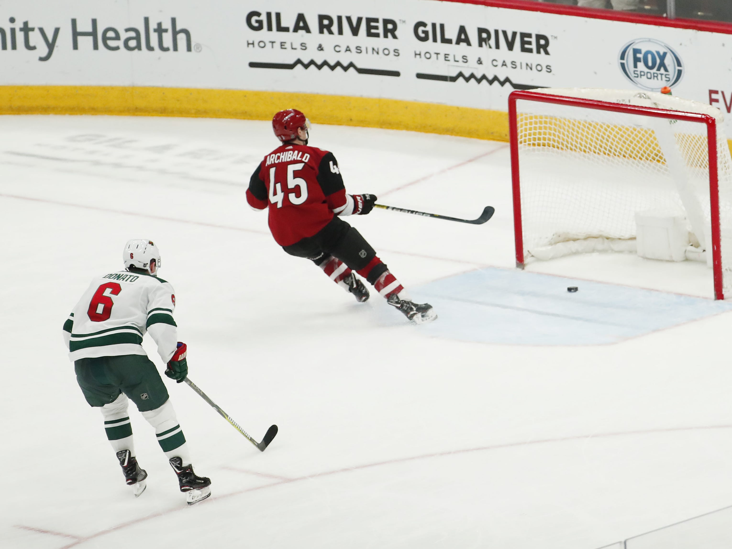 Arizona Coyotes right wing Josh Archibald (45) scores an empty-net goal against the Minnesota Wild during the third period in Glendale March 31, 2019.