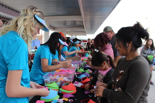 Volunteers help attendees at Phoenix Rescue Mission's community Easter celebration in March 2018 at the Transforming Lives Center.