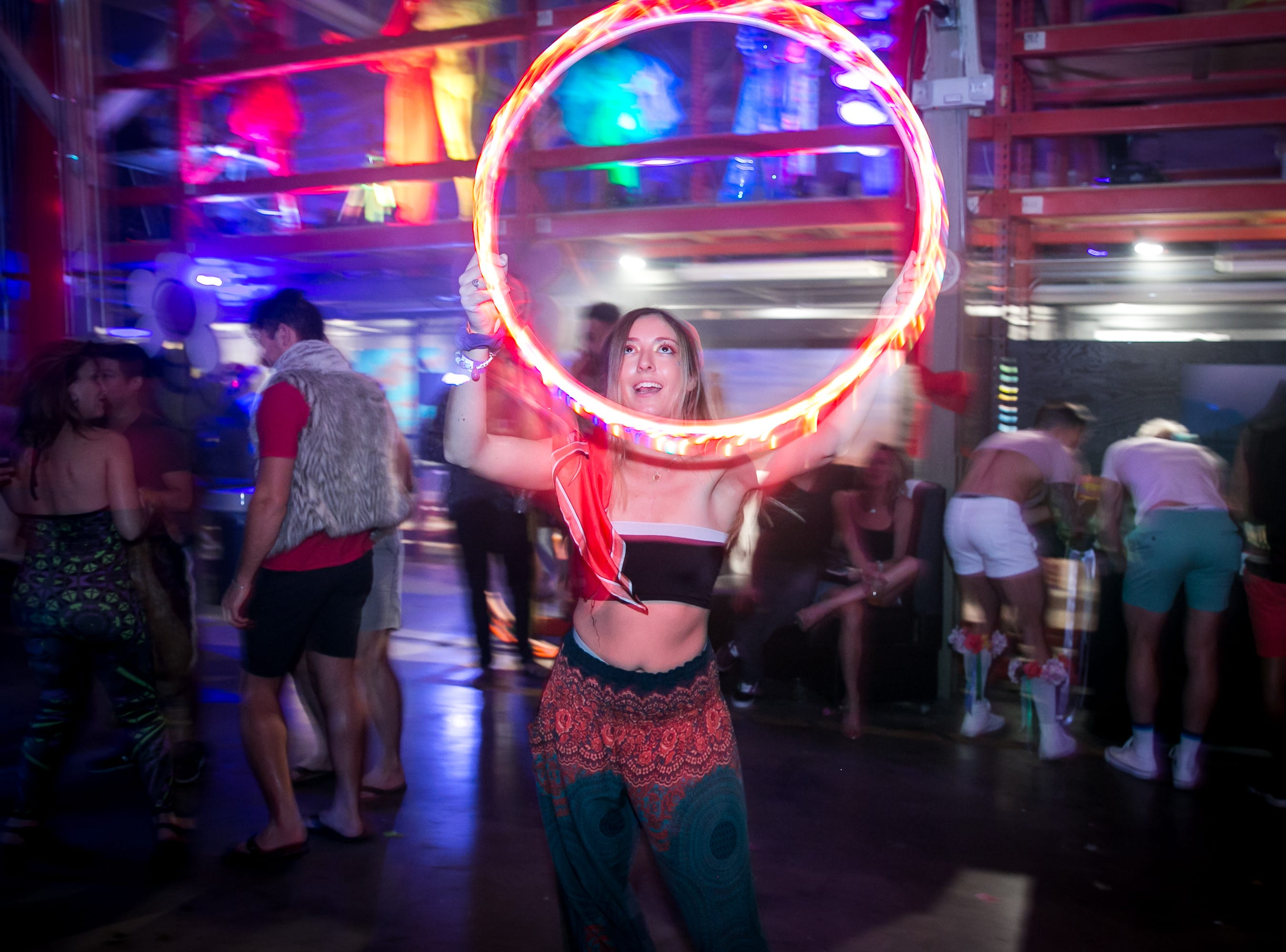 This attendee dances during Bloom at The Where?House Gallery on March 30, 2019.